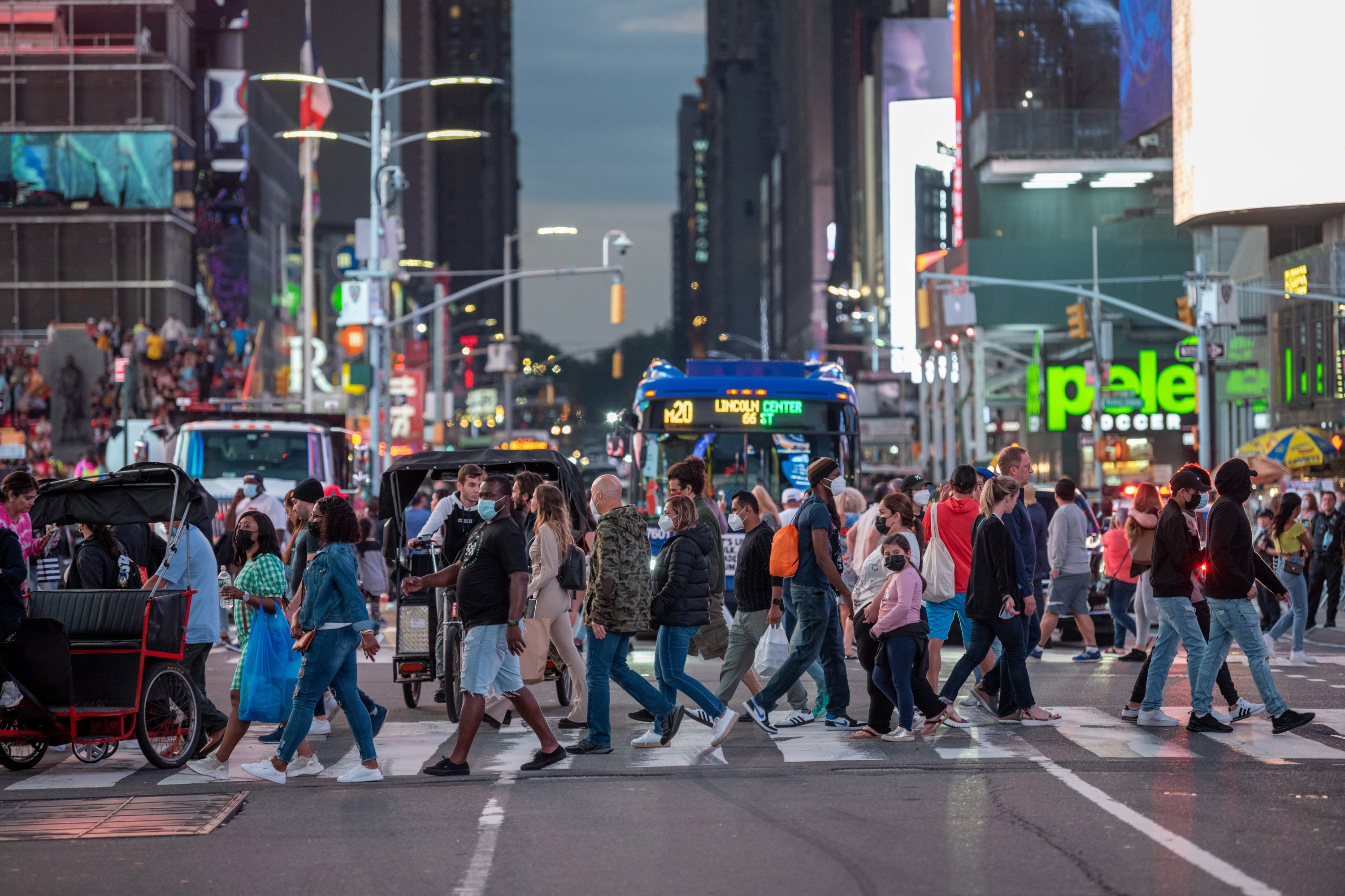 Large crowds of people mostly without masks fill Times Square, in the New York City, U.S., June 12, 2021. (Photo by Getty Images)