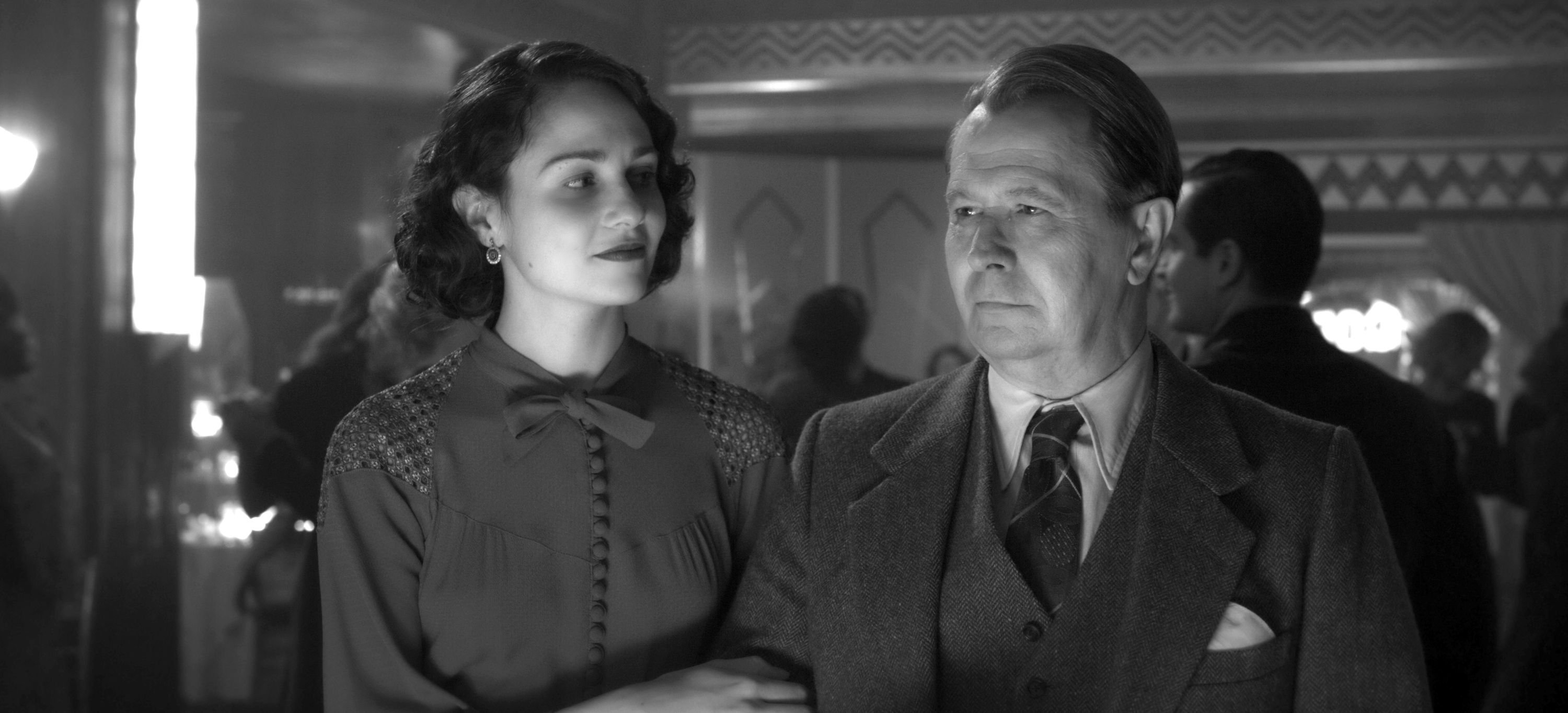 Tuppence Middleton (L) and Gary Oldman in a scene from 'Mank.'