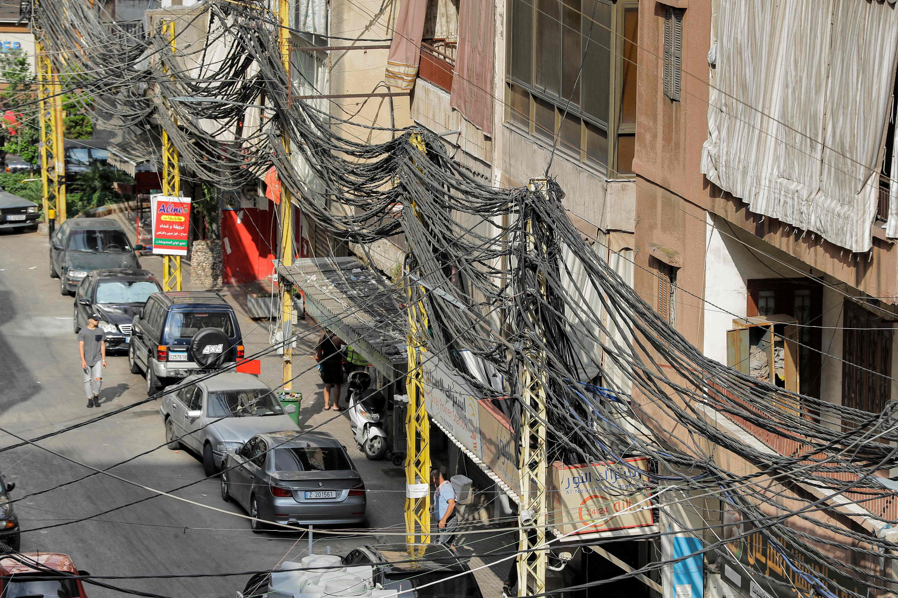 A view of a chaotic mesh of electricity lines along a street in a suburb of Beirut, Lebanon, June 23, 2021. (AFP Photo)