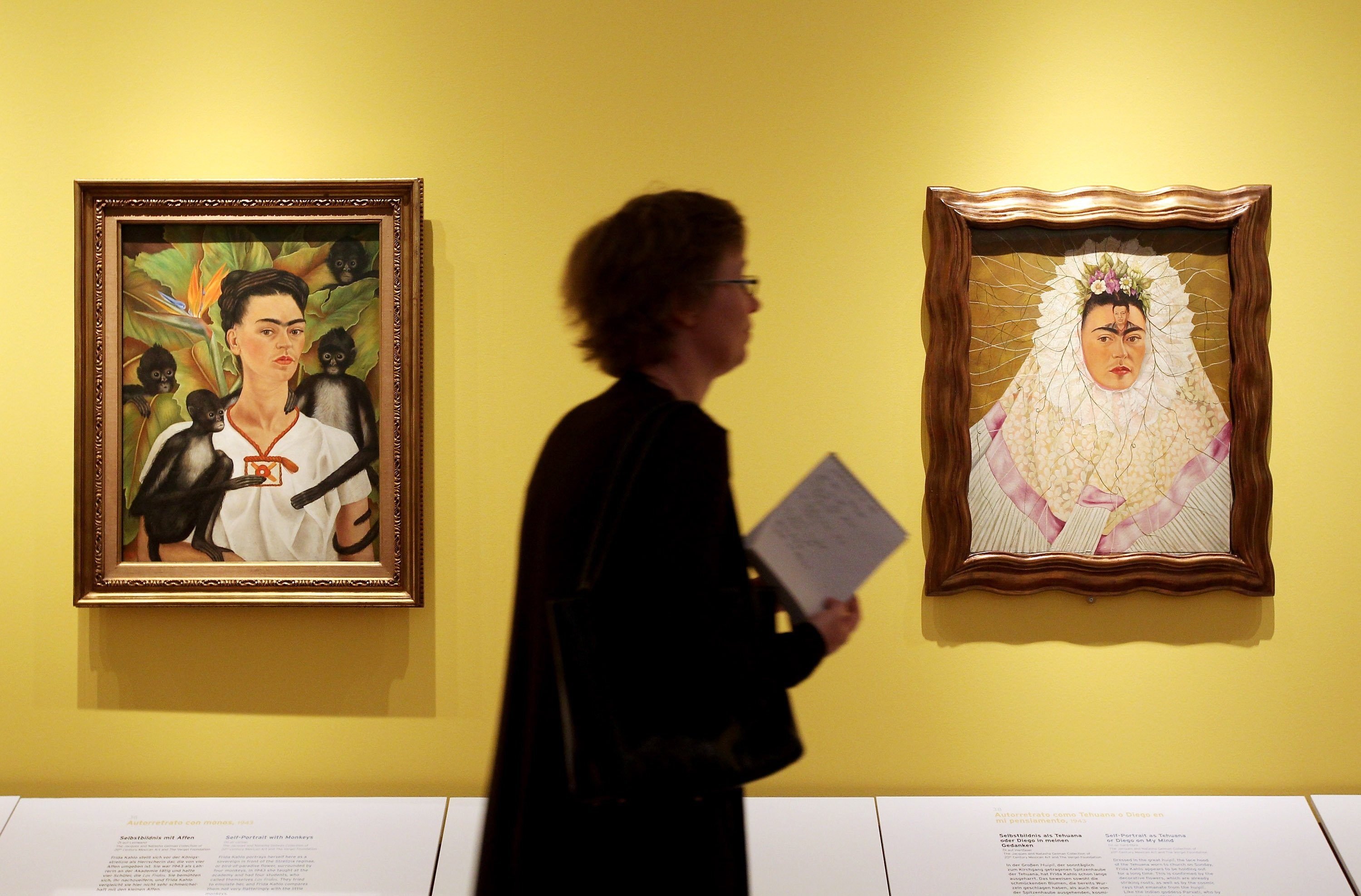 A visitor looks at self-portraits by Mexican painter Frida Kahlo at the Frida Kahlo Retrospective at Martin-Gropius-Bau, Berlin, Germany, April 29, 2010. (Getty Images)