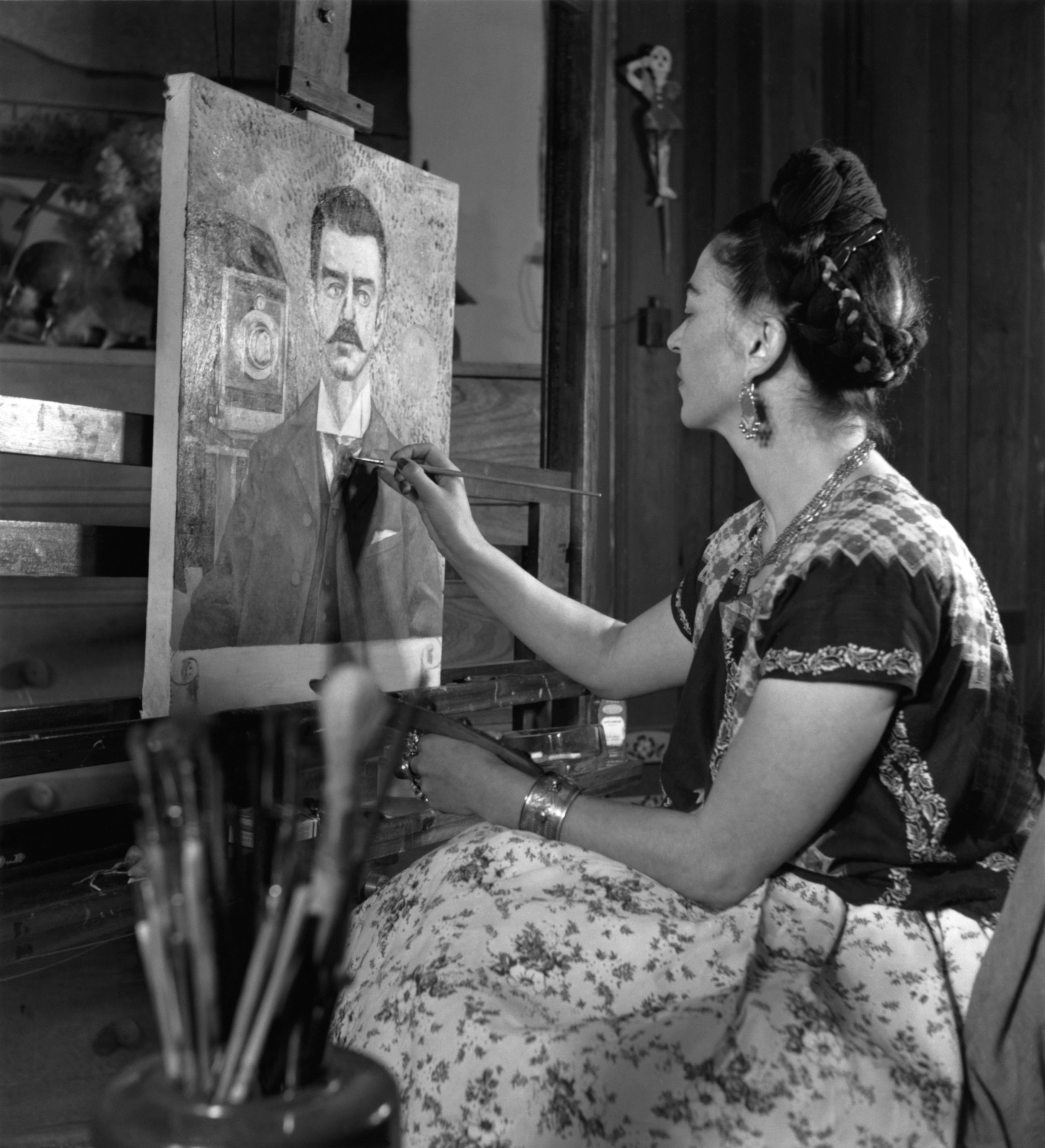 Mexican artist Frida Kahlo (1907-1954) as she paints her father's portrait, Mexico, 1952. (Getty Images)