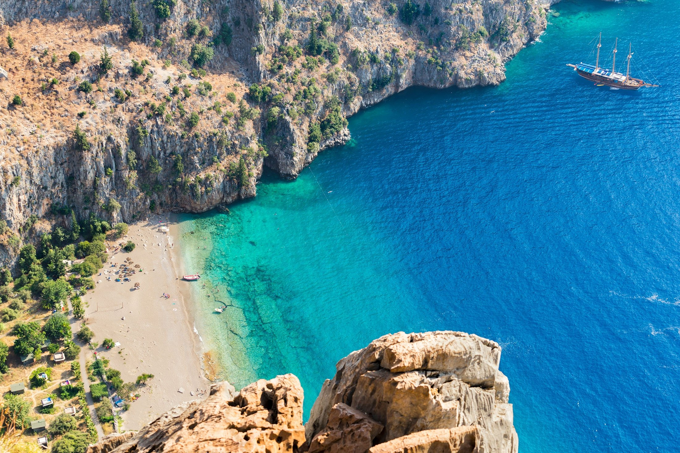 Top view of clear beach and transparent sea of Butterfly Valley. (Shutterstock Photo)