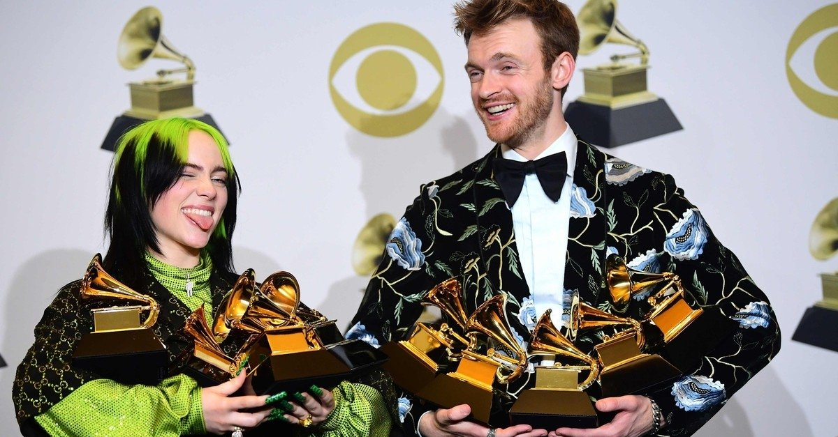 U.S. singer-songwriter Billie Eilish (L) and brother U.S. producer Finneas accept the award for Song Of The Year for ,Bad Guy, during the 62nd Annual Grammy Awards on January 26, 2020, in Los Angeles. (AFP Photo)