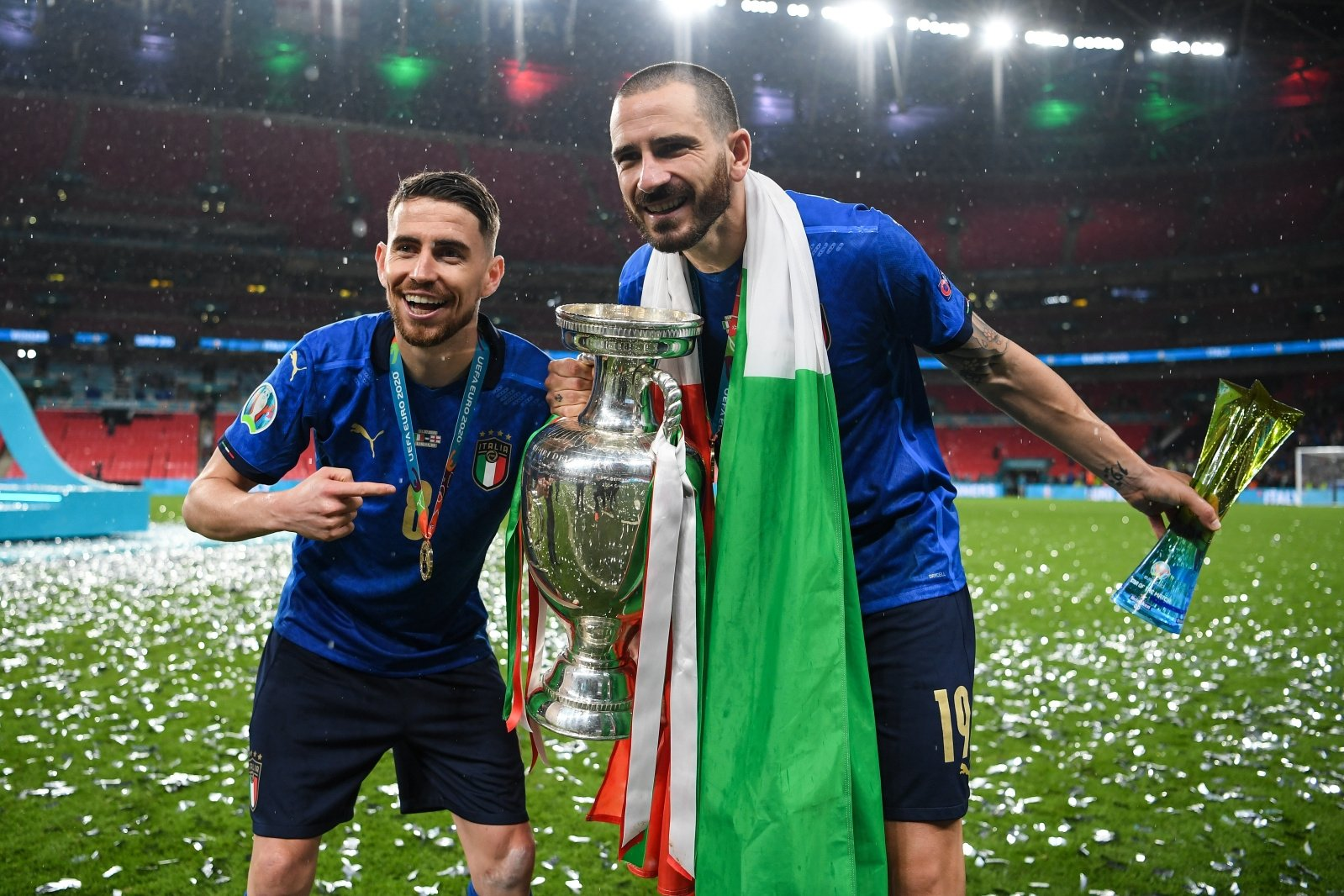 Italy's Jorginho and Leonardo Bonucci celebrate with the trophy after beating England in the Euro 2020 final at Wembley, London, England, July 11, 2021. (AA Photo)