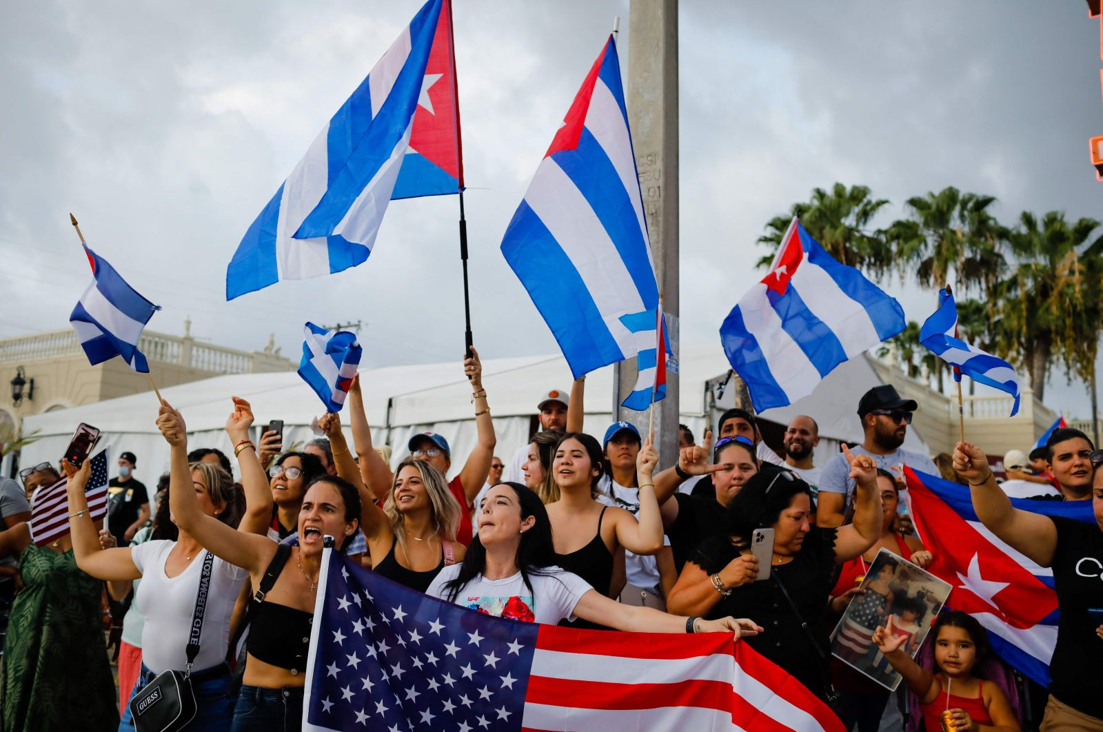 People demonstrate, some holding Cuban and US flags, during a protest against the Cuban government at Versailles Restaurant in Miami, Florida, July 12, 2021.(Photo by Eva Marie UZCATEGUI / AFP)