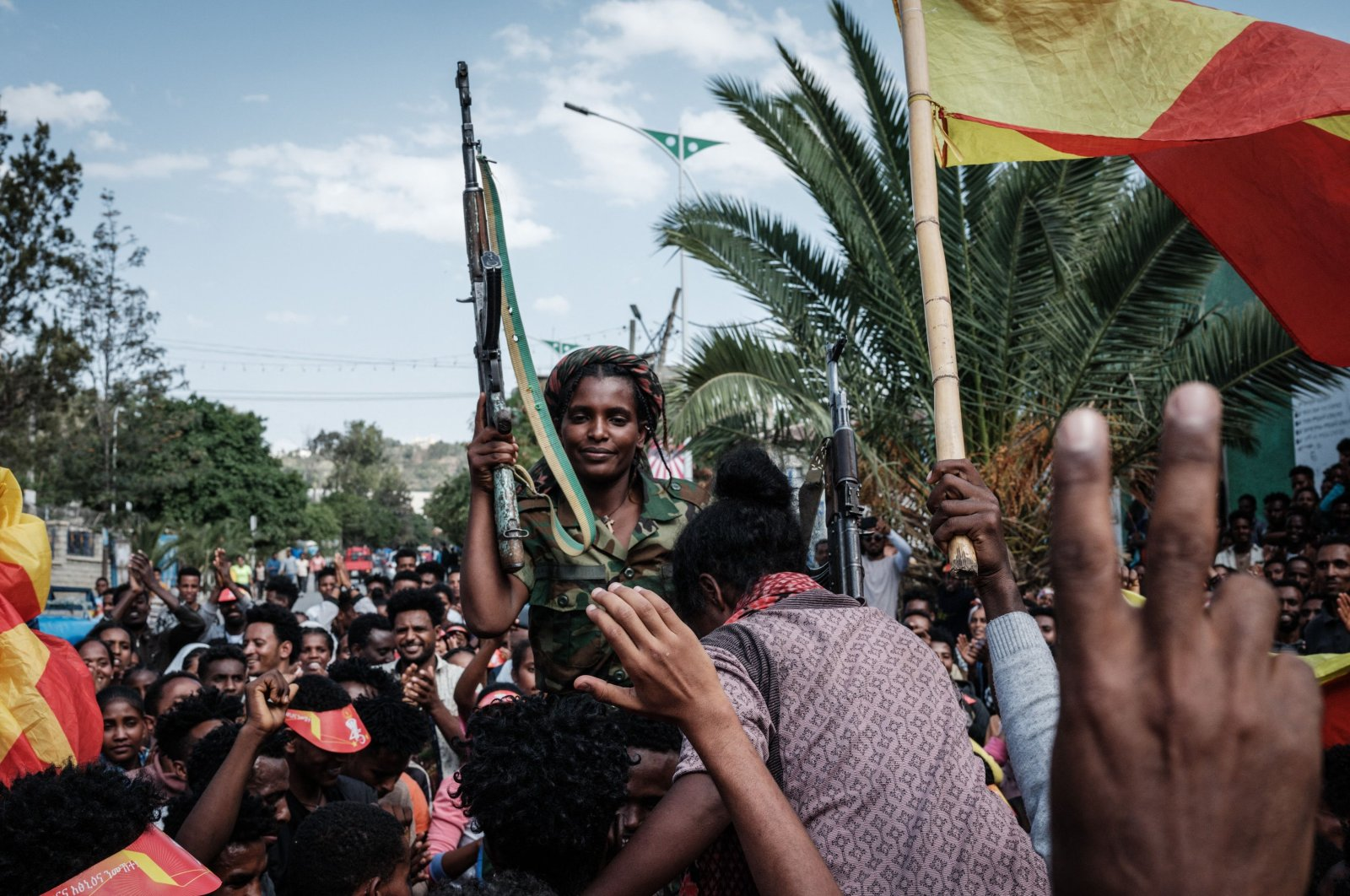 Soldiers of the Tigray Defense Force (TDF) celebrate their return on a street in Mekele, the capital of Tigray region, Ethiopia, June 29, 2021. (AFP Photo)