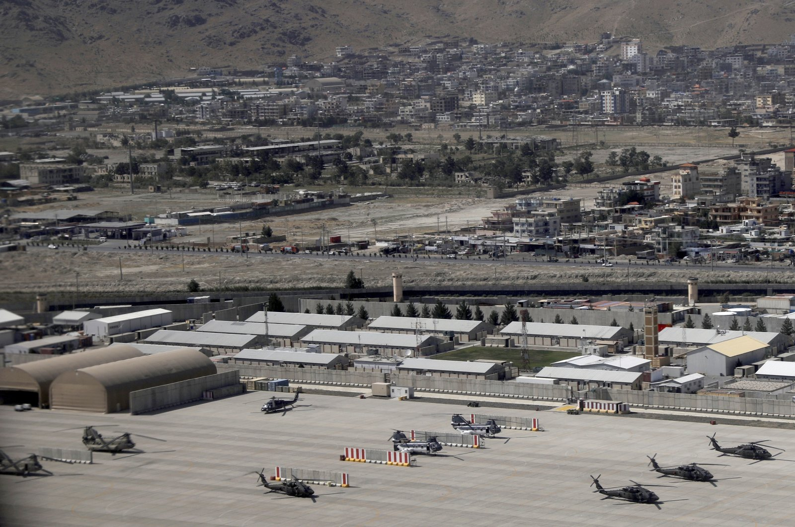 Kabul Military Airport as seen through a window of a commercial airplane, Kabul, Afghanistan, July 7, 2021. (AP Photo)