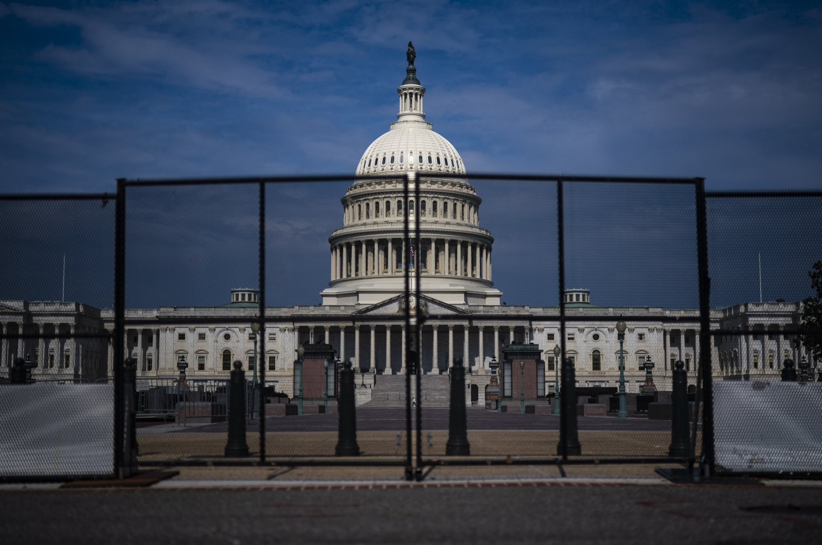 Fencing, that was erected after the Jan. 6 riot, is seen surrounding the Capitol building on Capitol Hill, in Washington, D.C., U.S., July 9, 2021. (Photo by Getty Images)