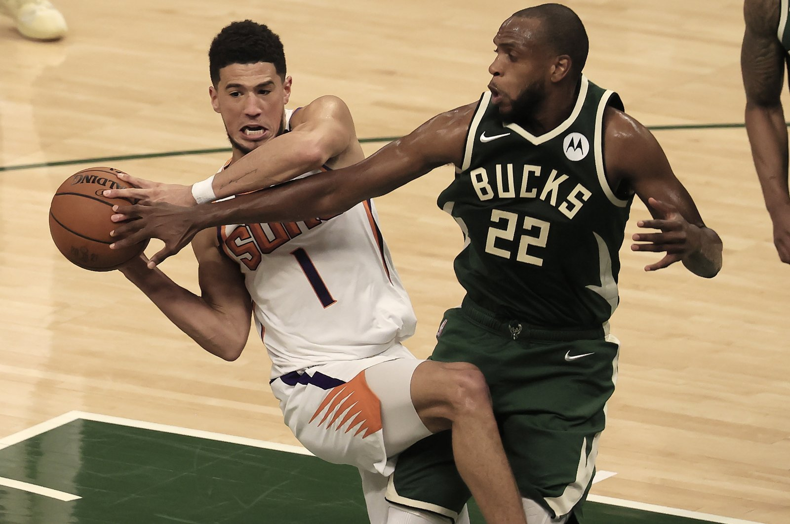 Milwaukee Bucks forward Khris Middleton (R) guards Phoenix Suns guard Devin Booker (L) during Game 3 of the 2021 NBA Finals at Fiserv Forum in Milwaukee, Wisconsin, U.S., July 11, 2021. (EPA Photo)