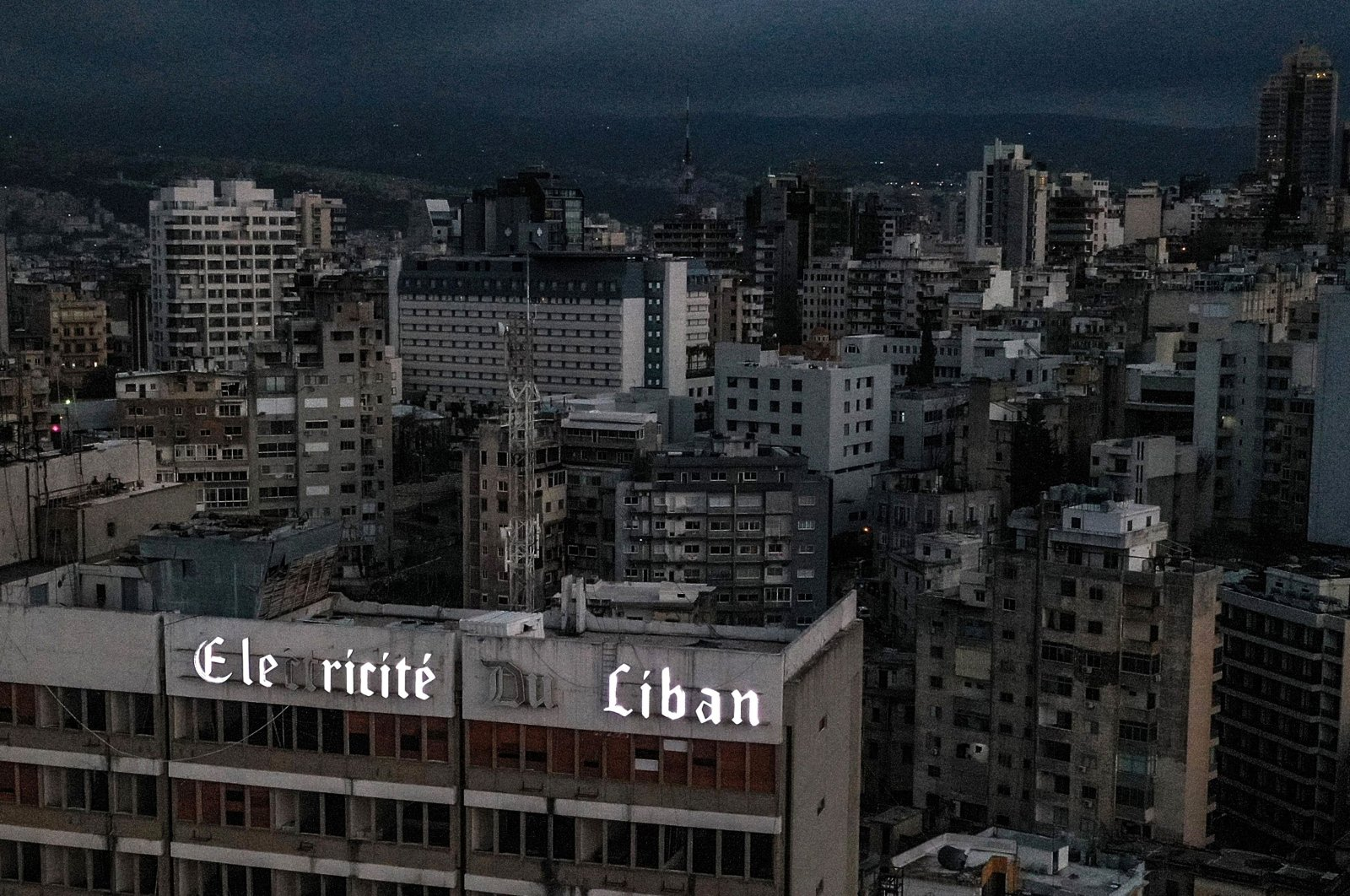 An aerial view of Beirut during a power outage, with the Electricite du Liban (Electricity Of Lebanon) company headquarters in the foreground, Beirut, Lebanon, April 3, 2021. (AFP Photo)