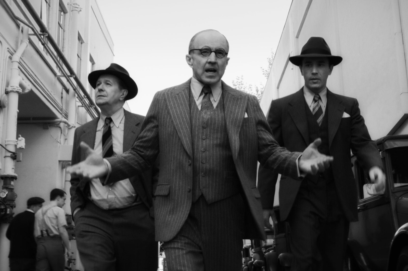 "From left to right, Gary Oldman as Herman Mankiewicz, Arliss Howard as Louis B. Mayer and Tom Pelphrey as Joe Mankiewicz in a scene from ""Mank."""