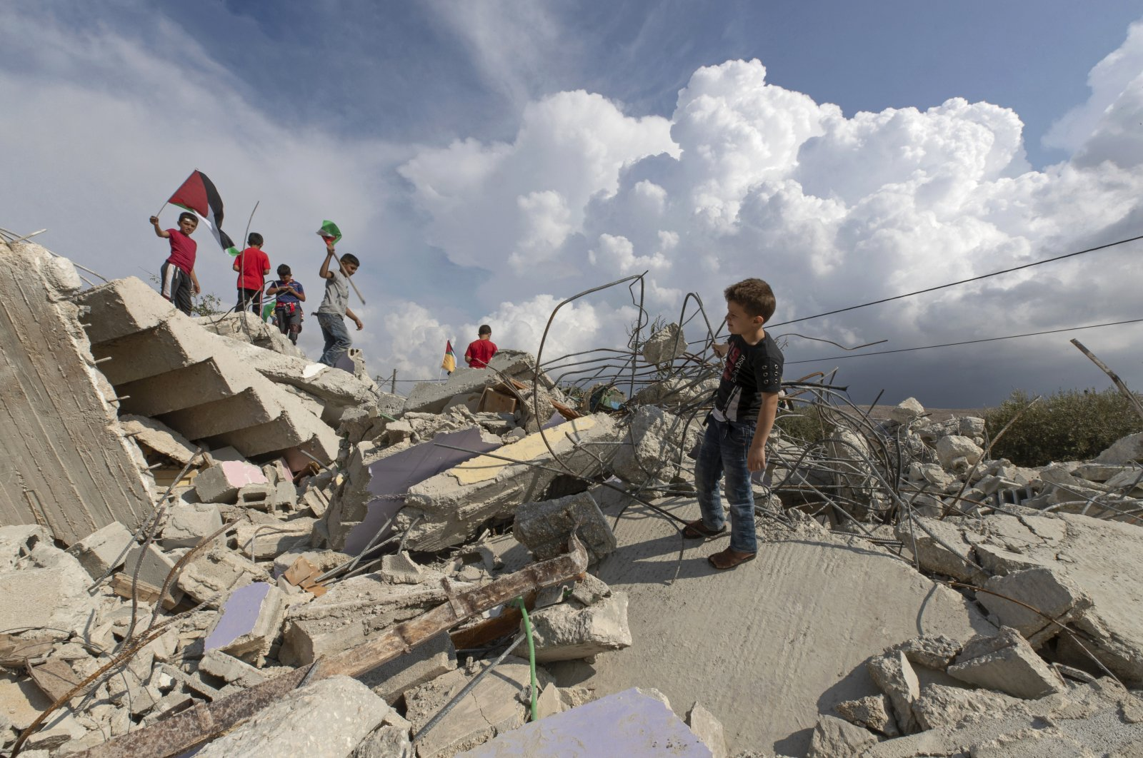 Palestinian children play on top of the demolished house of Khalil Dweikat, in the occupied West Bank village of Rojeeb, Palestine, Nov. 2, 2020. (AP File Photo/Nasser Nasser)