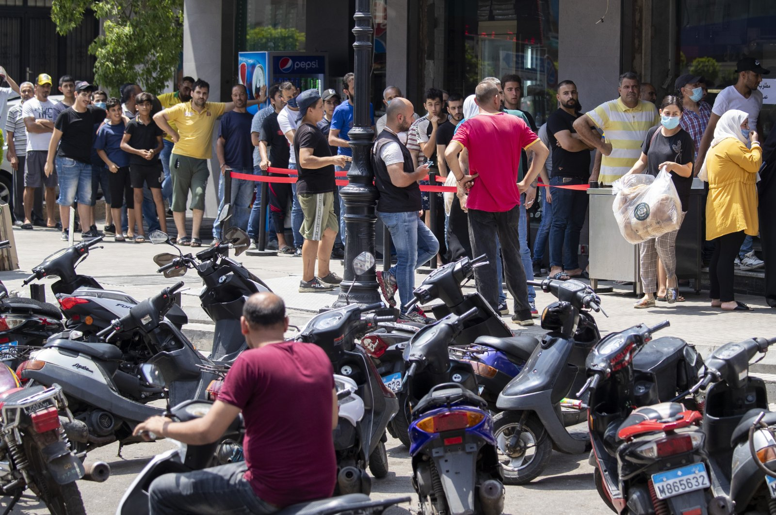 People queue for bread outside a bakery in Beirut, Lebanon, June 27, 2020. (AP Photo)