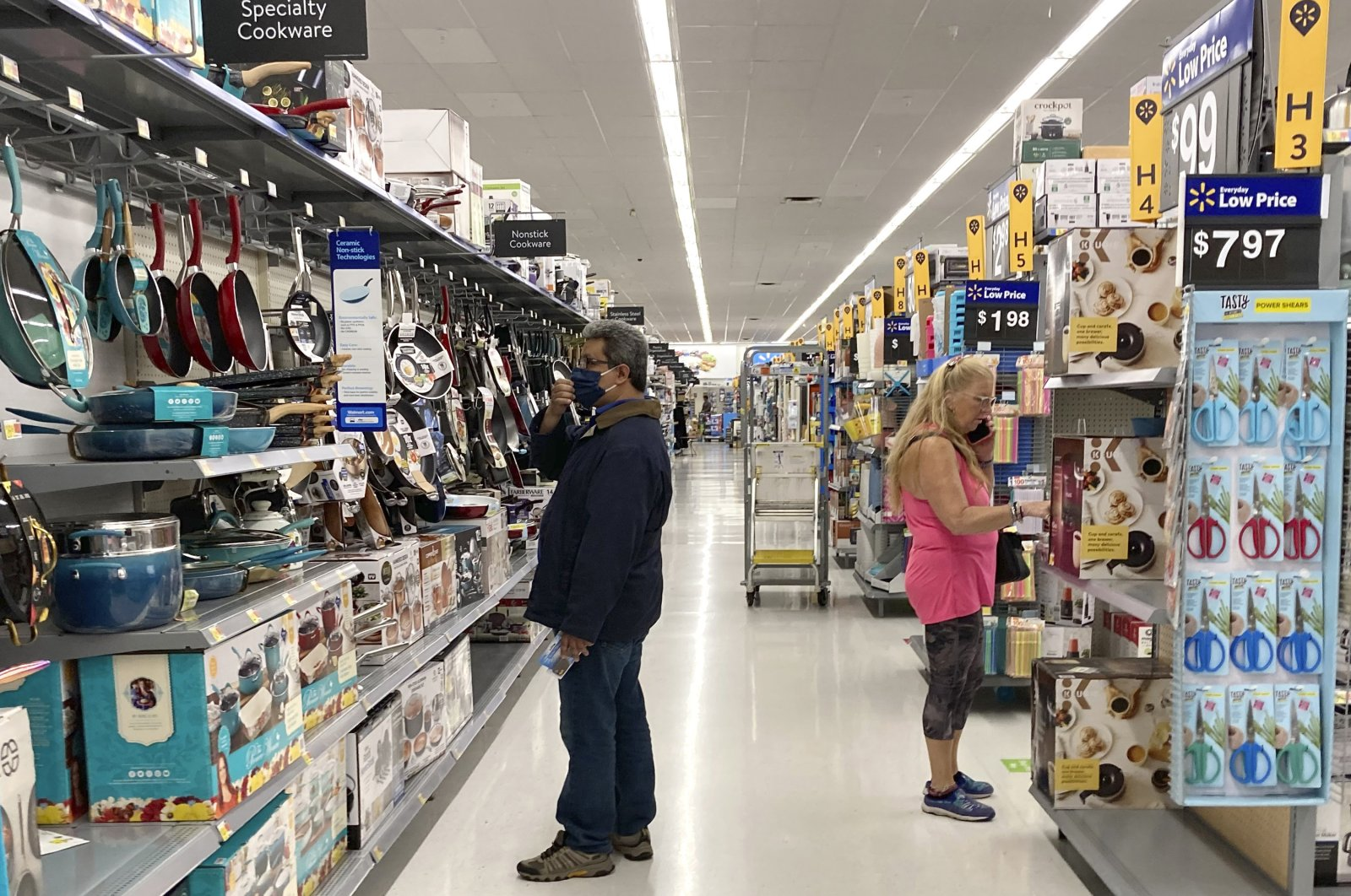 Consumers shop as they wear a mask at a Walmart store in Vernon Hills, Illinois, U.S., May 23, 2021. (AP Photo)