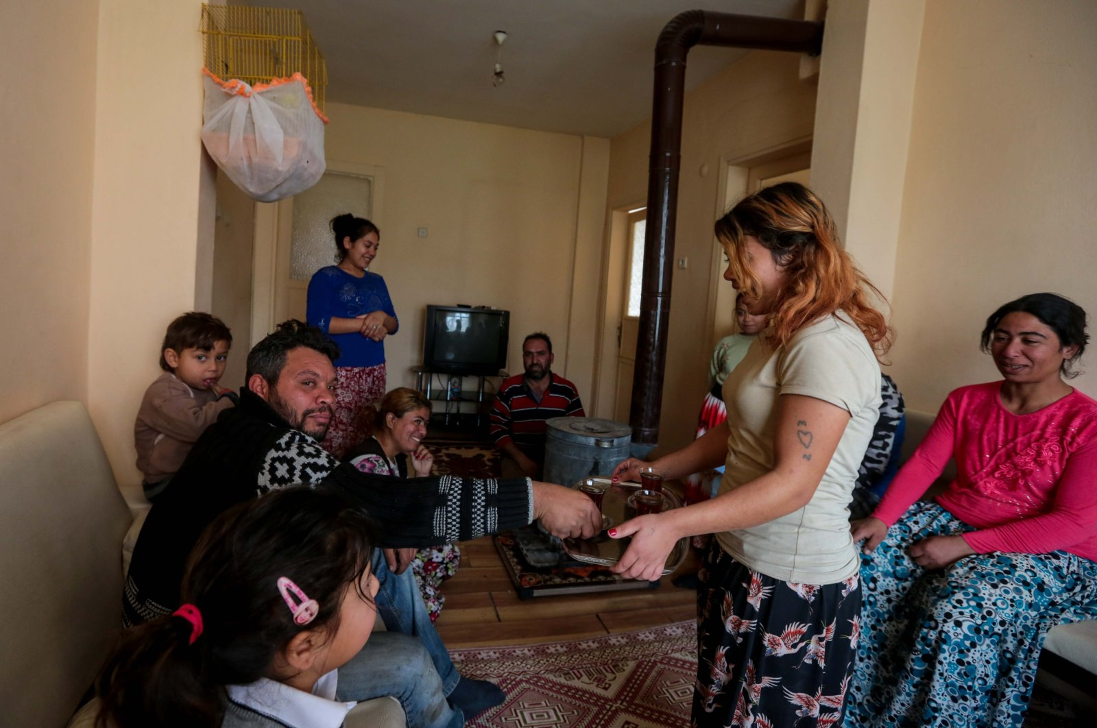 A Roma family in their new home built by public agencies and NGOs in the Sultanbeyli district, Istanbul, Turkey, May 9, 2019. (PHOTO BY UĞUR YILDIRIM)