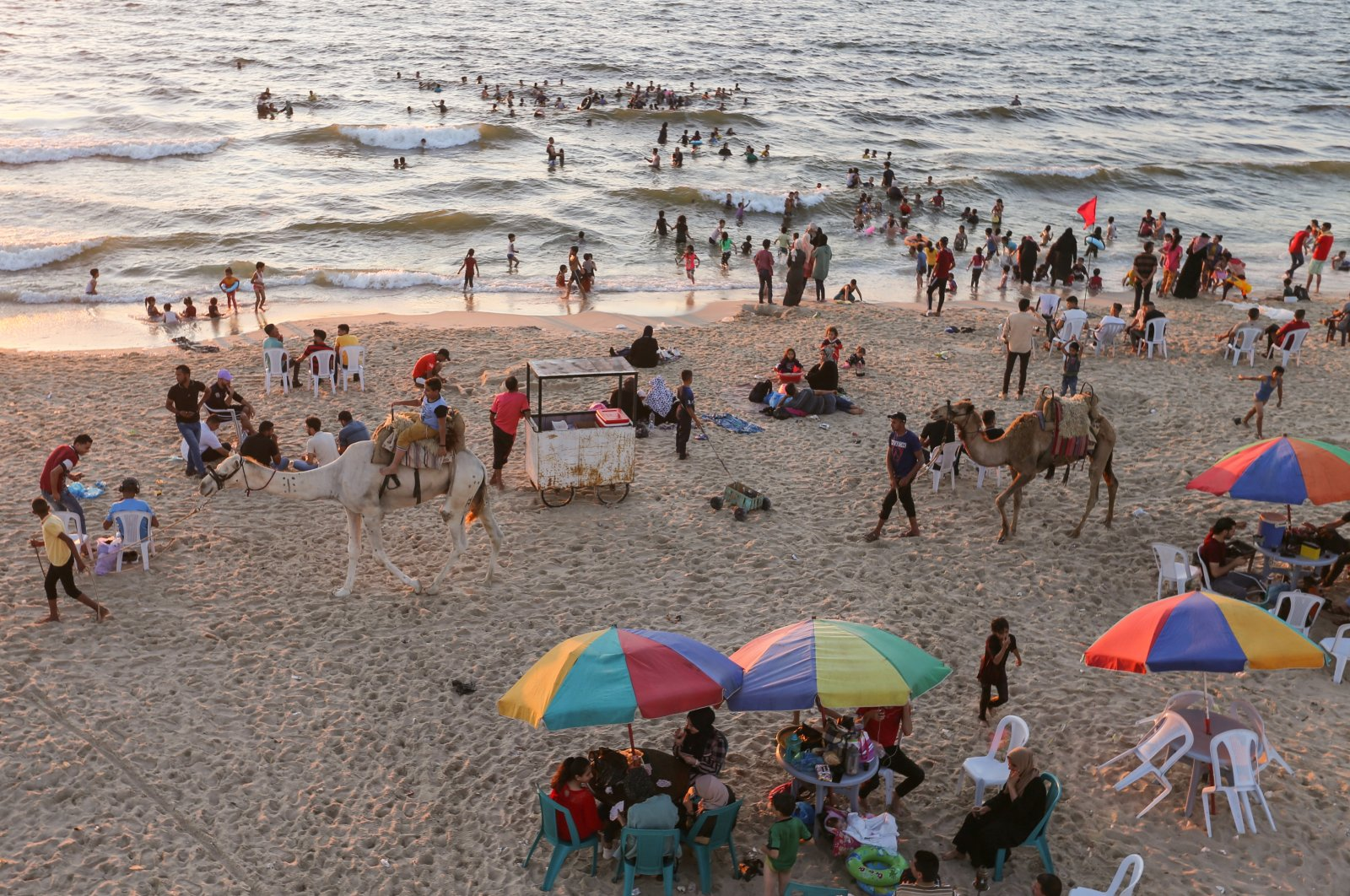 Palestinians spend time at a beach in Gaza, Palestine, July 8, 2021. (REUTERS)
