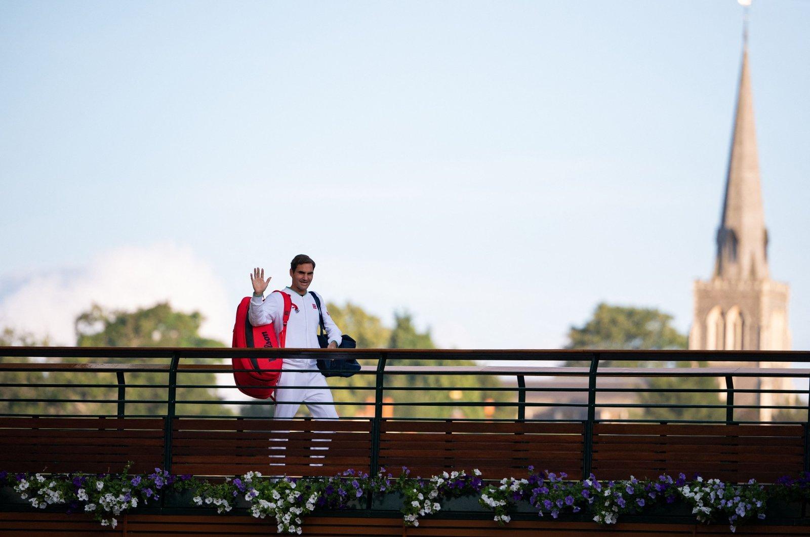 Switzerland's Roger Federer waves to fans after losing his men's quarter-finals match at the 2021 Wimbledon Championships, Wimbledon, southwest London, U.K., July 7, 2021. (AFP Photo)