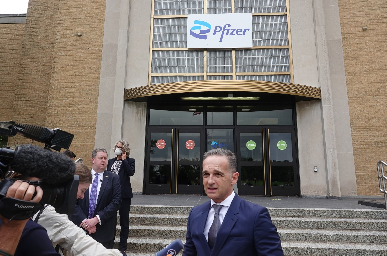 Germany's Foreign Minister Heiko Maas stands in front of the production facility of the US pharmaceutical company Pfizer in Kalamazoo, July 13, 2021. (DPA via Reuters)