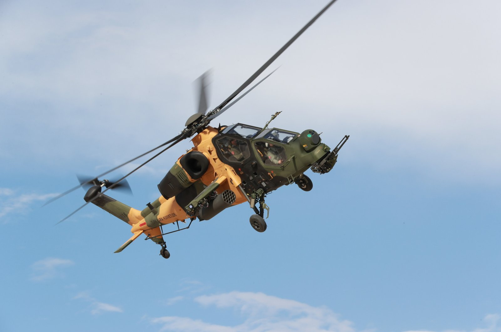 A TAI-made ATAK helicopter is seen flying in the sky in this photo provided on July 13, 2021. (IHA Photo)