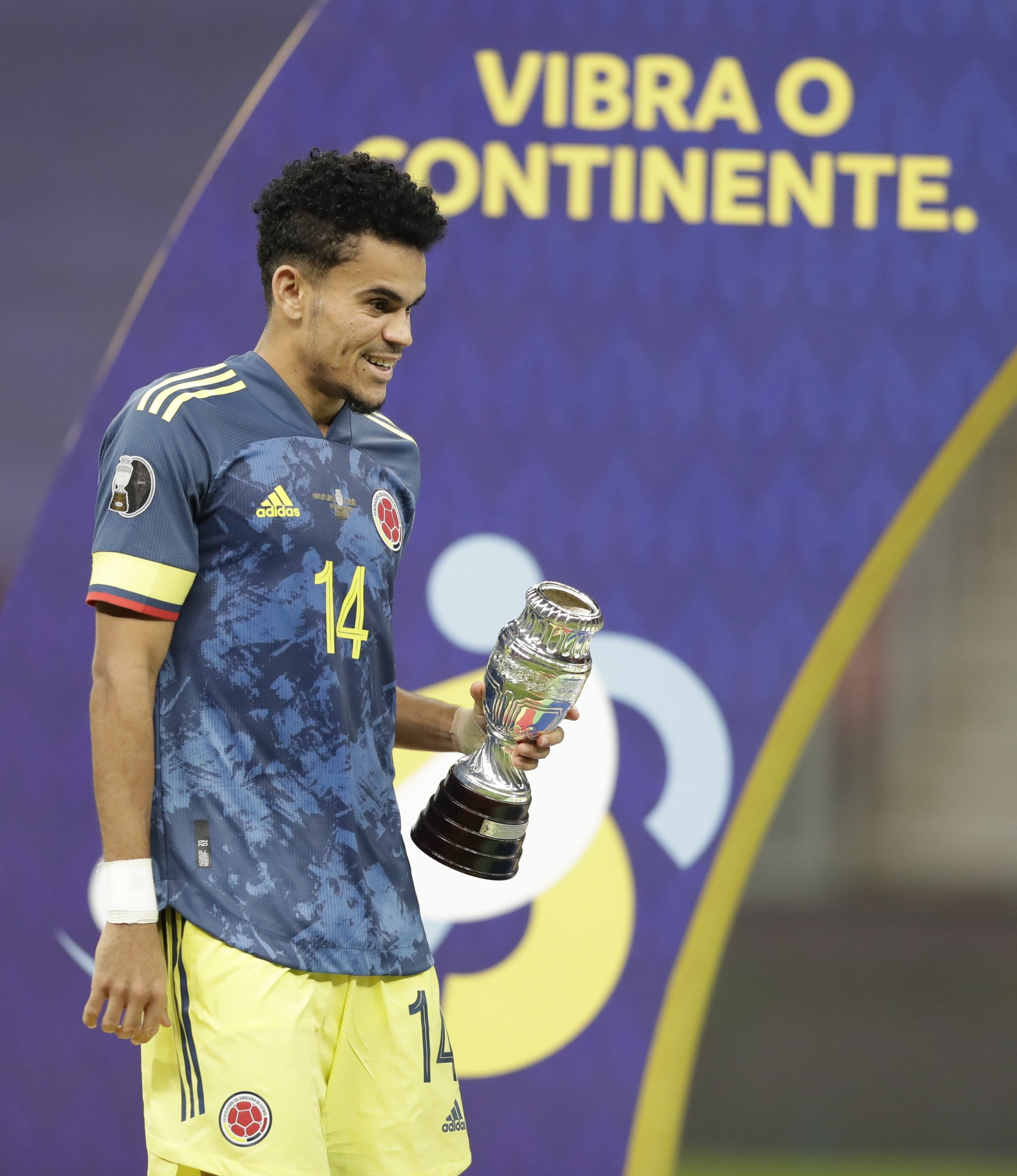 Colombia's Luis Diaz holds the best player of the match trophy after beating 3-2 Peru in the Copa America match for third place at the National Stadium in Brasilia, Brazil, July 9, 2021. (AP Photo)