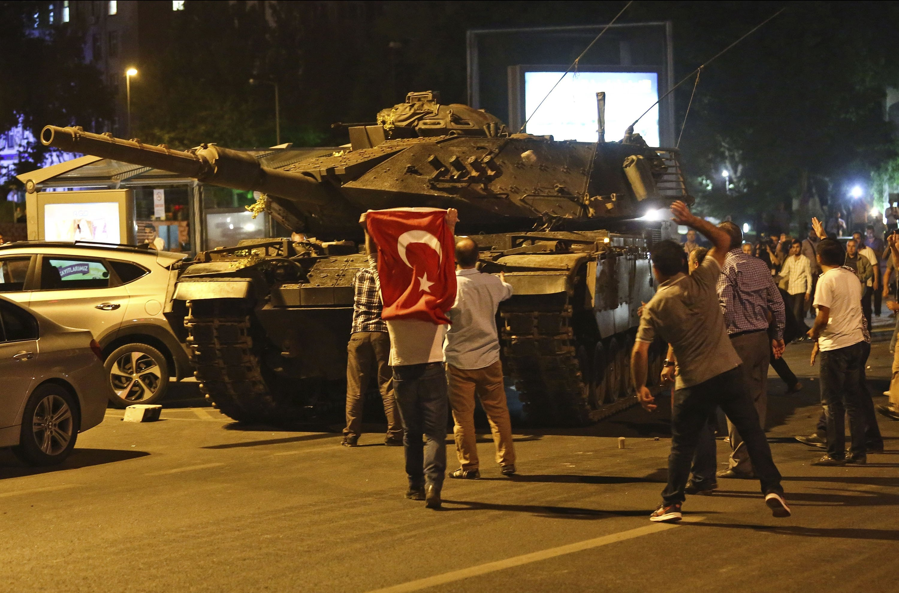 Tanks, part of the forces that attempted a coup, move into position as people attempt to stop them, in Ankara, Turkey, July 16, 2016. (AP Photo)