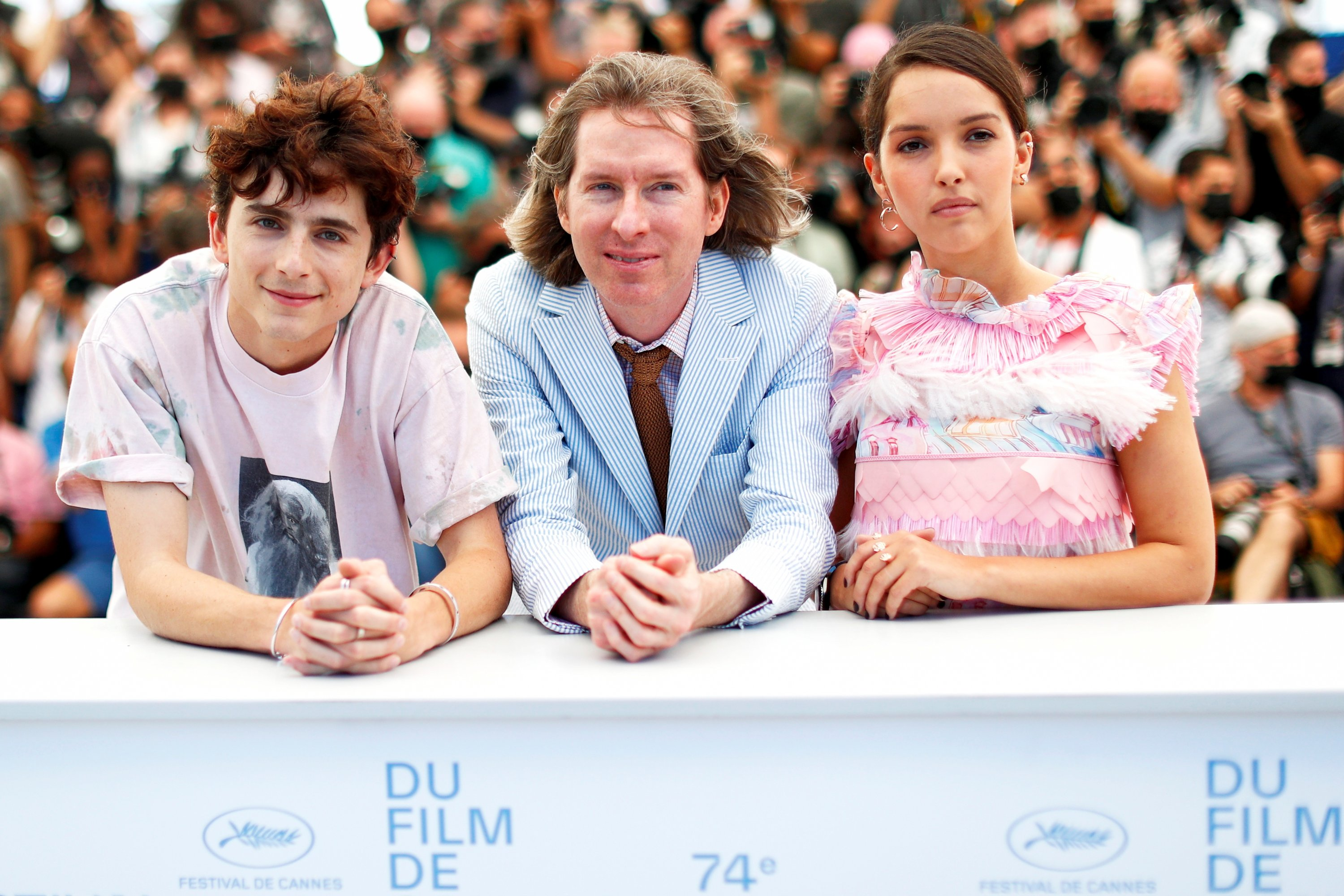 Director Wes Anderson (C) and cast members Timothee Chalamet (L) and Lyna Khoudri pose during a photocall for the film'The French Dispatch,' at the 74th Cannes Film Festival inCannes, France, July 13, 2021. (Reuters Photo)