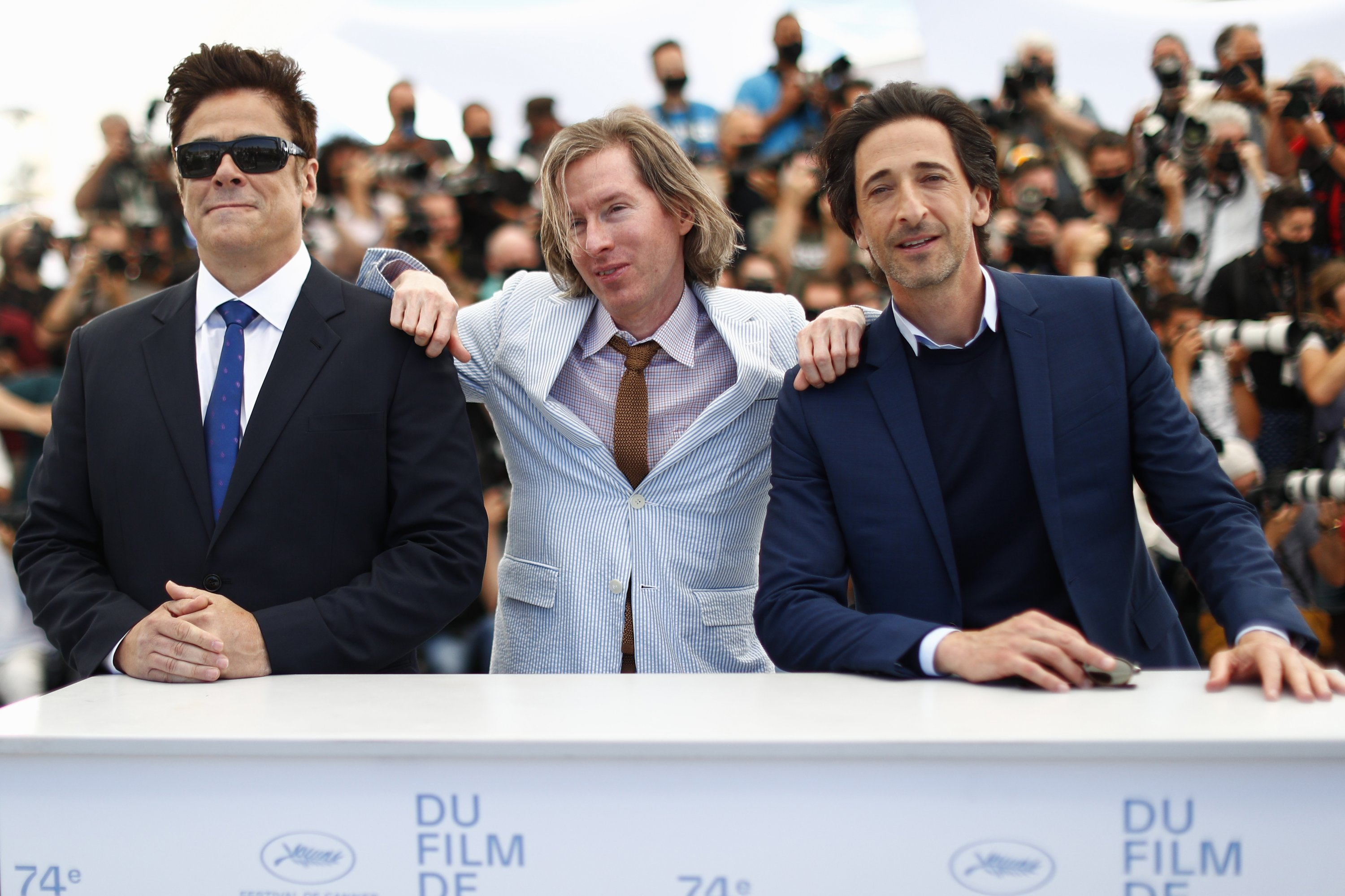 Director Wes Anderson (C) and cast members Benicio Del Toro (L) and Adrien Brody pose during a photocall for the film'The French Dispatch,' at the 74th Cannes Film Festival inCannes, France, July 13, 2021. (Reuters Photo)