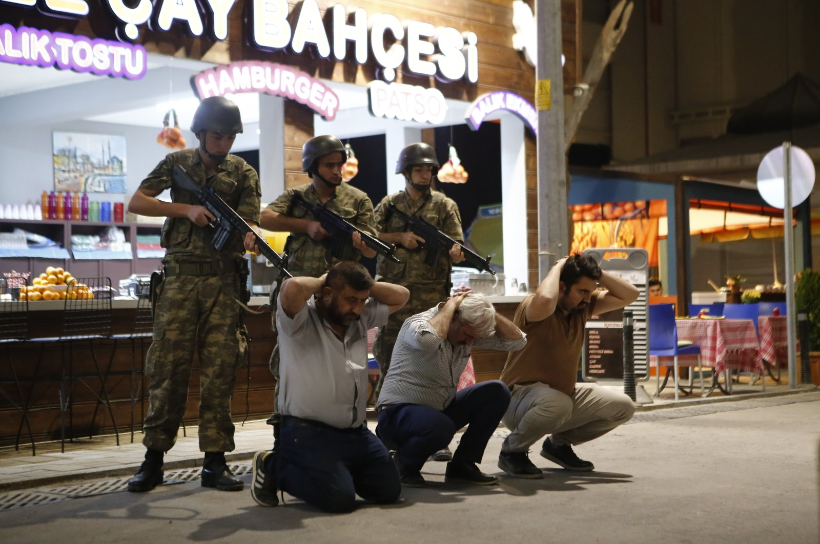 """Soldiers hold citizens at gun point in a scene from""""15/07: Şafak Vakti."""""""