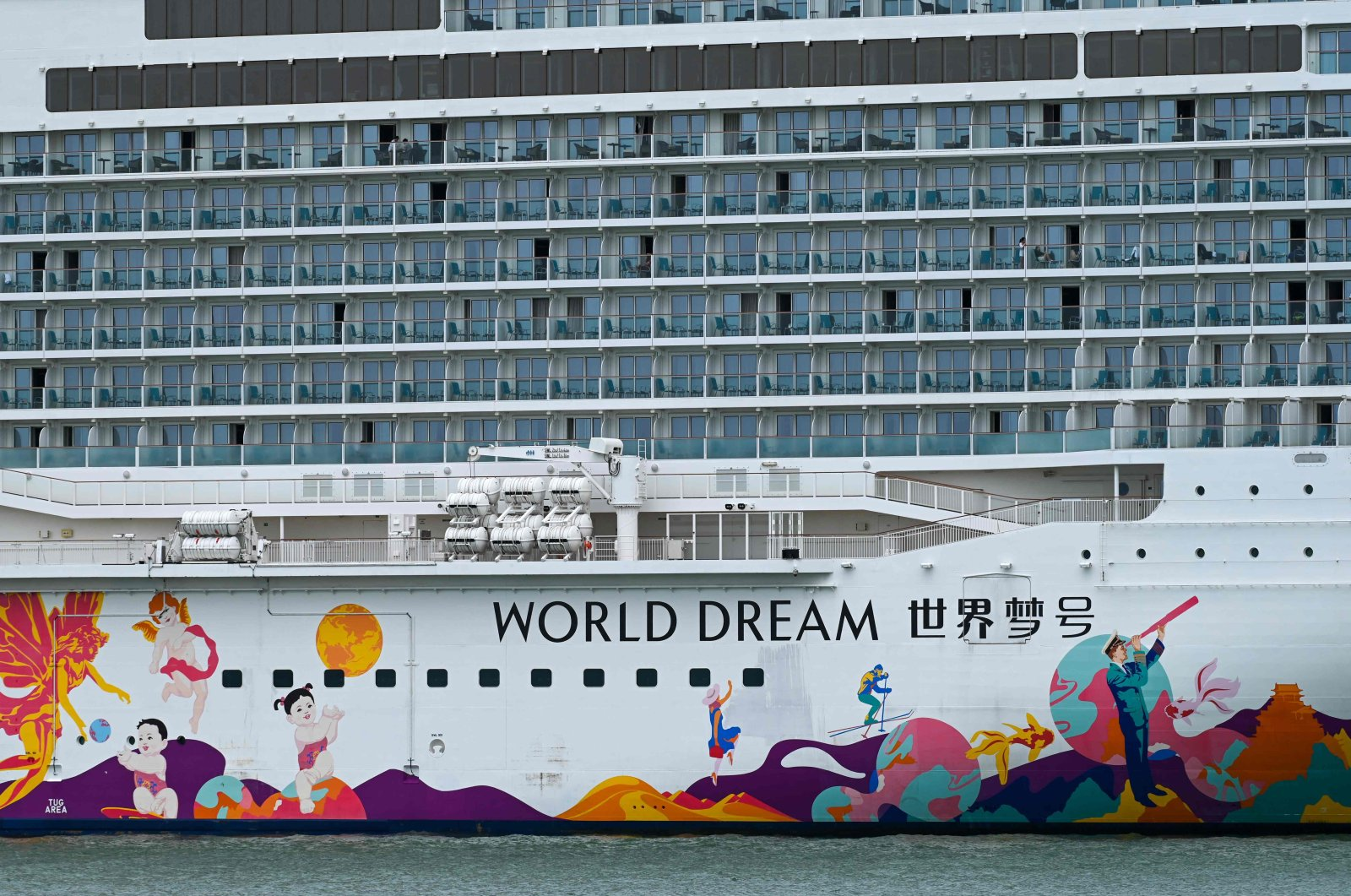 People are seen on board the Dream Cruises' World Dream cruise ship after it returned to the city-state following a passenger testing positive for the coronavirus, the Marina Bay Cruise Centre Singapore, Singapore, July 14, 2021. (AFP Photo)