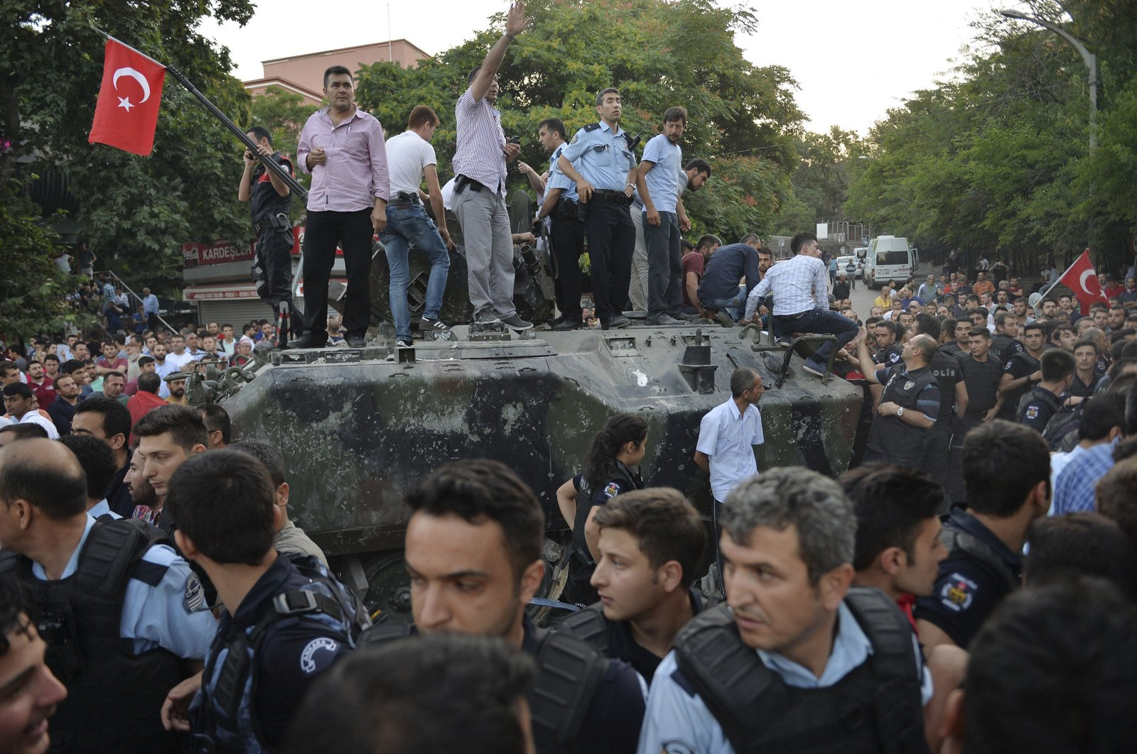 People gather and some stand atop a Turkish army armored vehicle during the attempted coup in Ankara, Turkey, July 16, 2016. (AP Photo)