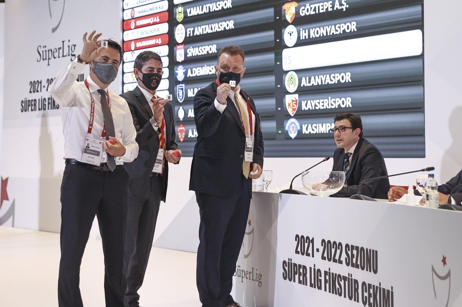 Fenerbahçe managing committee memberSelahattin Baki (L),Galatasaray'sŞükrü Haneda (2nd L) andBeşiktaş'sKemal Erdoğan attends the fixture draw for the 2021/22 Turkish Süper Lig season at the TFF headquarters at Riva, Istanbul, Turkey, July 13, 2021. (AA Photo)