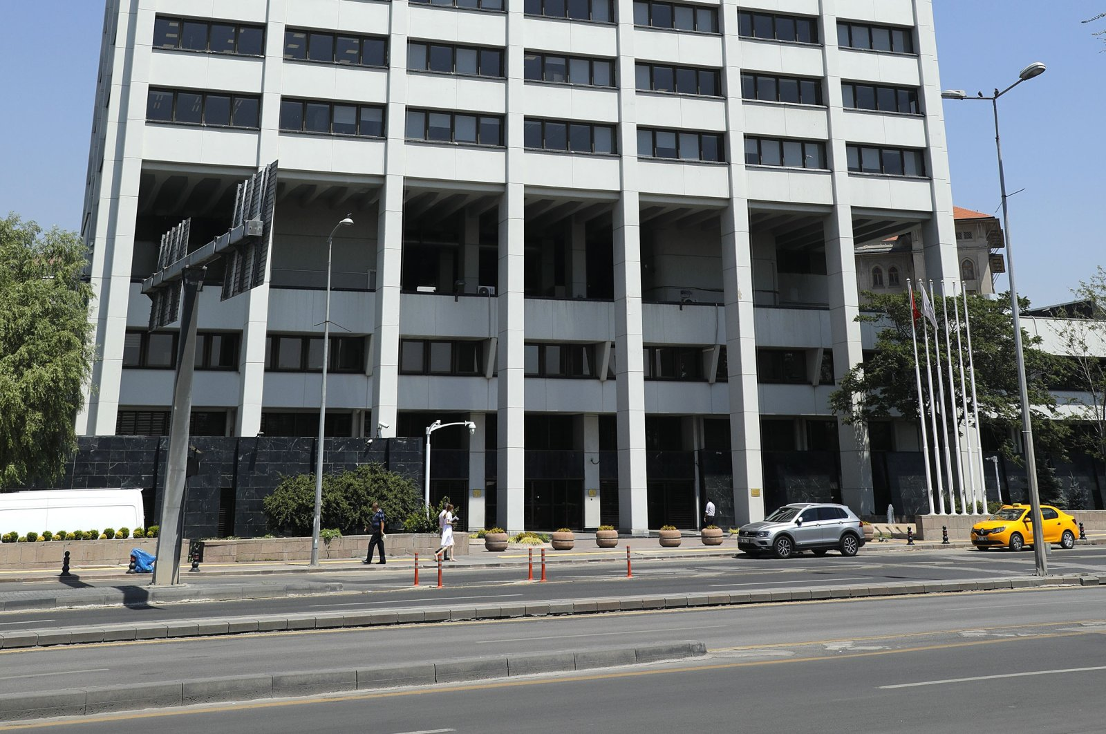 Pedestrians pass the headquarters of the Central Bank of the Republic of Turkey (CBRT) in Ankara, Turkey, July 31, 2019. (Getty Images)