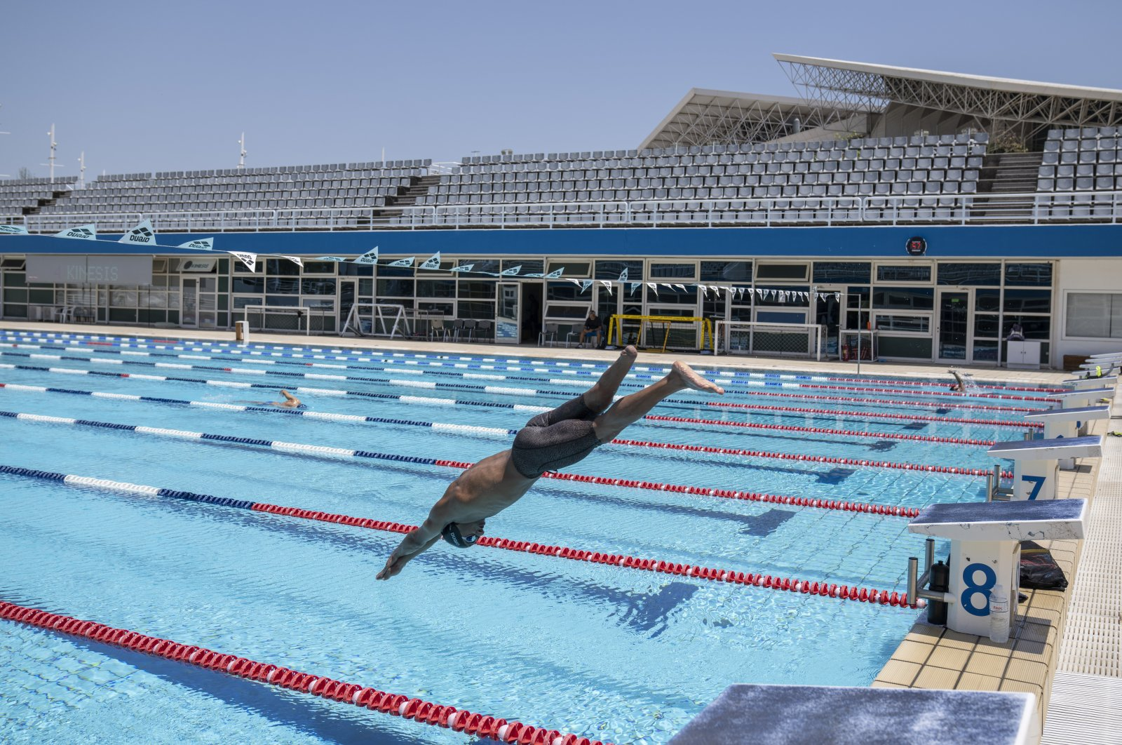 Syrian refugee Ibrahim al-Hussein, an amputee swimmer who lost his leg during the war in Syria, dives during training at the Olympic Aquatic Center, Athens, Greece, June 30, 2021. (AP Photo)