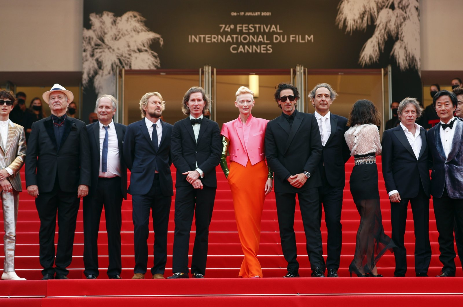 """Fromthe leftTimothee Chalamet, Bill Murray, Hippolyte Girardot,Owen Wilson, Wes Anderson,Tilda Swinton, Adrien Brody,Alexandre Desplat, Lyna Khoudri,Mathieu Amalric,Stephen Park, Benicio Del Toro,pose during a photocall for the film""""The French Dispatch,"""" at the 74th Cannes Film Festival inCannes, France, July 13, 2021. (Reuters Photo)"""