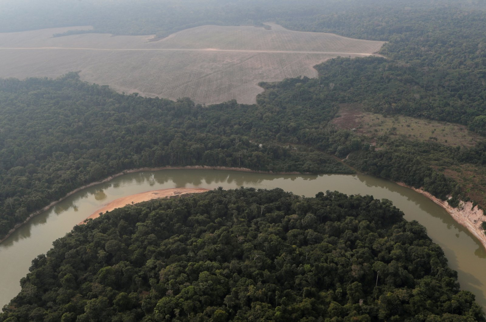 An aerial view of the Amazon forest shows a river and a deforested plot near Porto Velho, Rondonia State, Brazil, Aug. 14, 2020. (Reuters Photo)