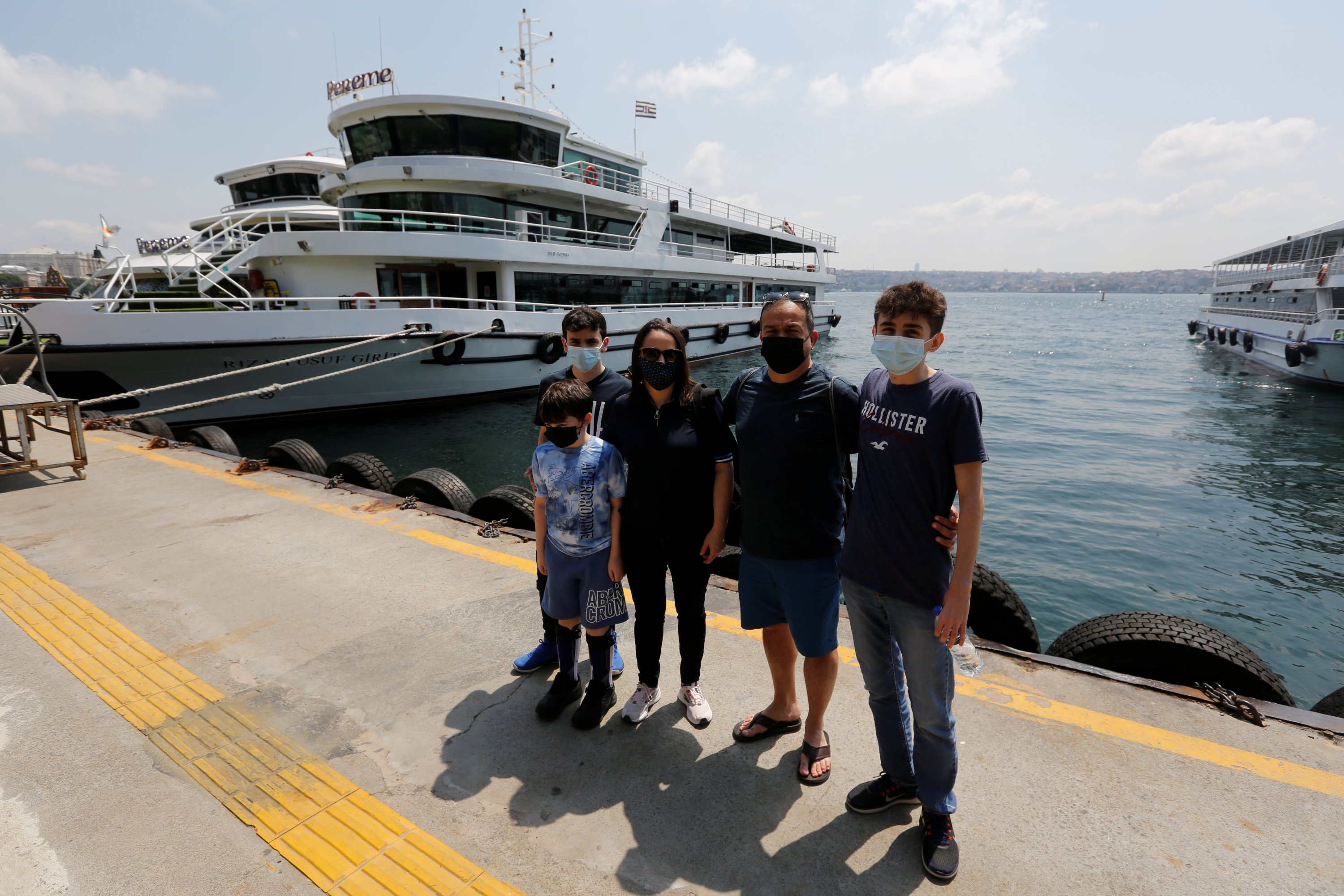 Jordanian couple Omar Zahra and Ghader Zahra pose with their children after a boat tour on the Bosporus in Istanbul, Turkey July 12, 2021. (Reuters Photo)