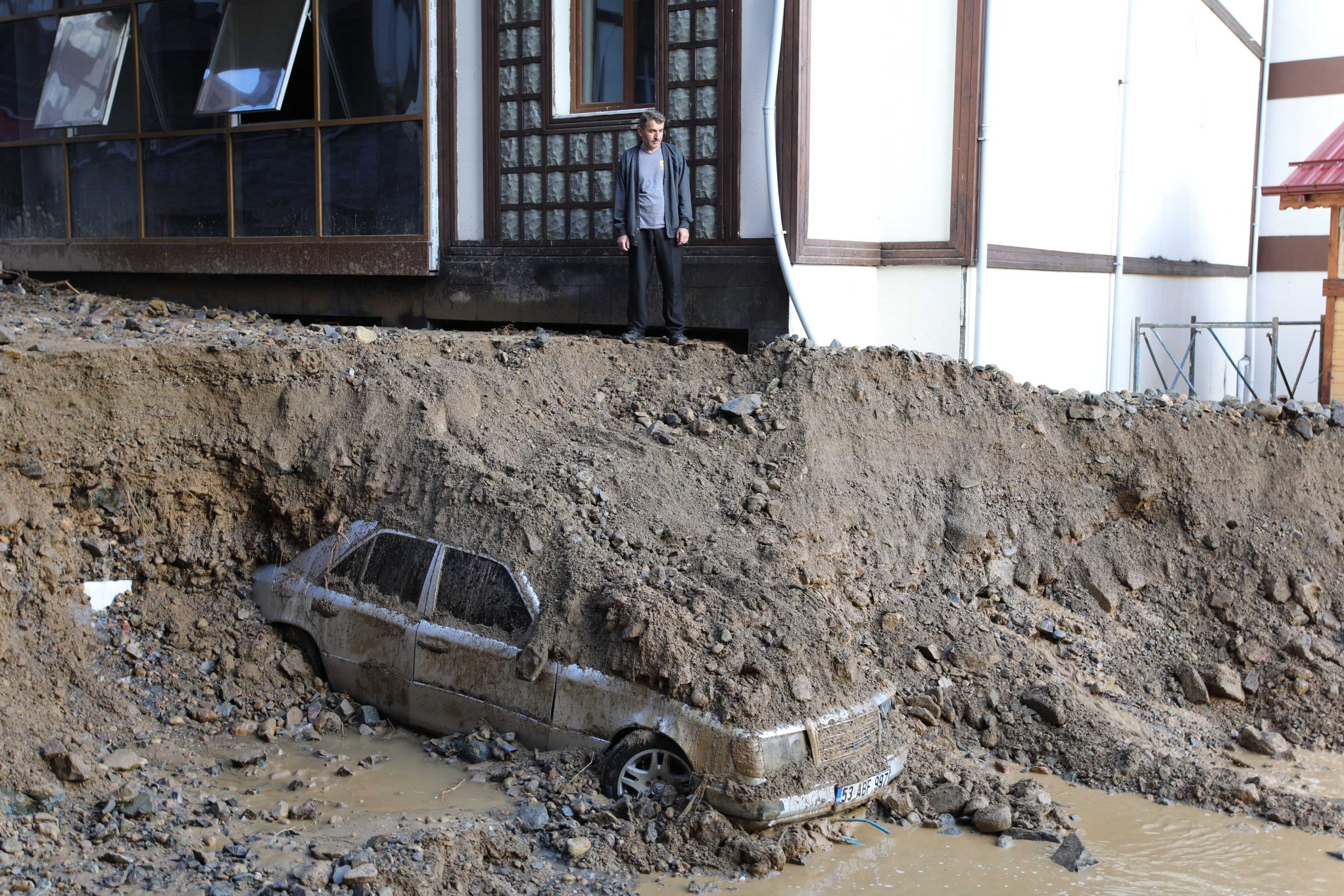 A car buried under soil in Güneysu district, in Rize, northern Turkey, July 15, 2021. (DHA Photo)