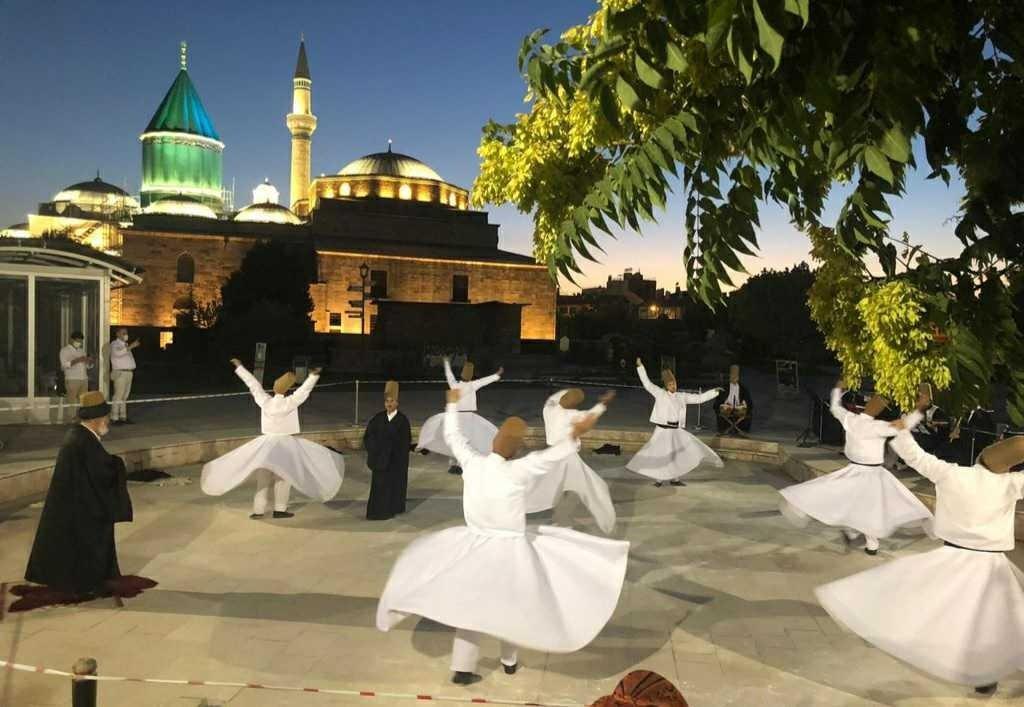 Dervishes conduct a Mevlevi Sema ceremony in the rose garden of the Mevlana Museum, Konya, Turkey, on July 8, 2021. (Daily Sabah via International Mevlana Foundation)