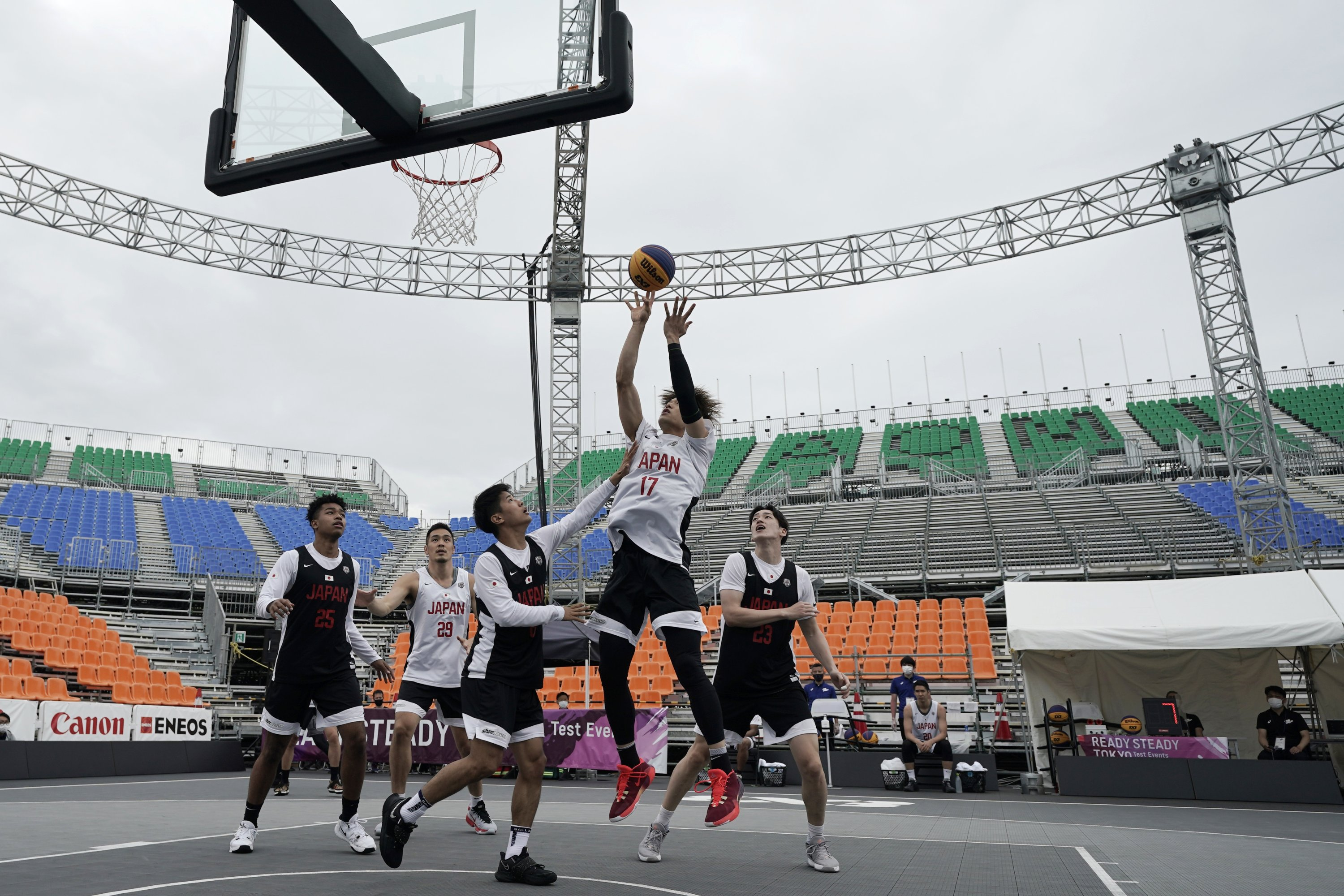 Athletes compete during the Tokyo 2020 Olympic Game men's basketball 3x3 test event at Aomi Urban Sports Park in Tokyo, Japan, May 16, 2021. (AP Photo)