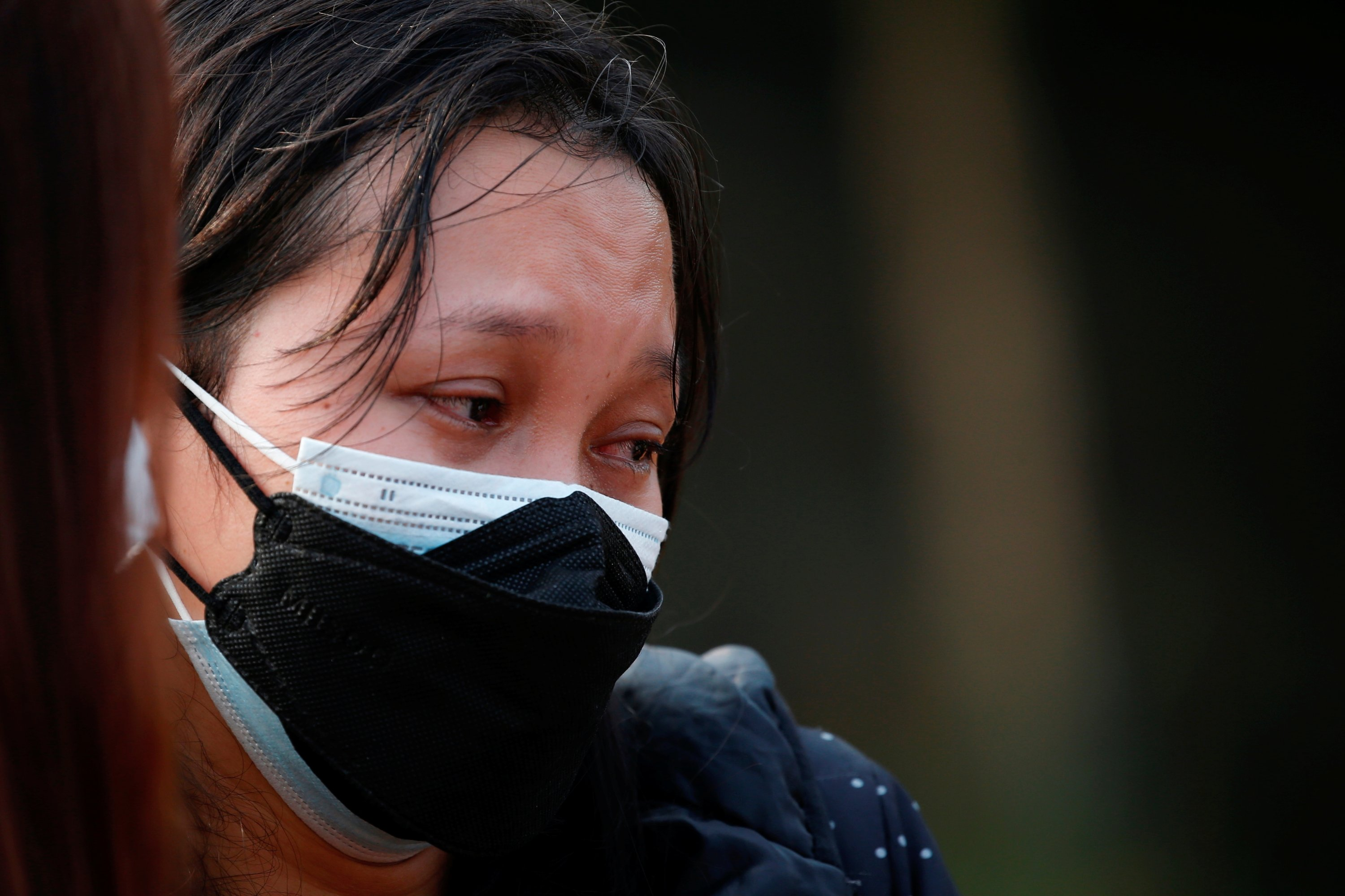 A woman cries as she attends the funeral of her 65-year-old father who passed away due to COVID-19, at a burial area provided by the government for COVID-19 victims as the case surges, in Bekasi, on the outskirts of Jakarta, Indonesia, July 15, 2021. (Reuters Photo)