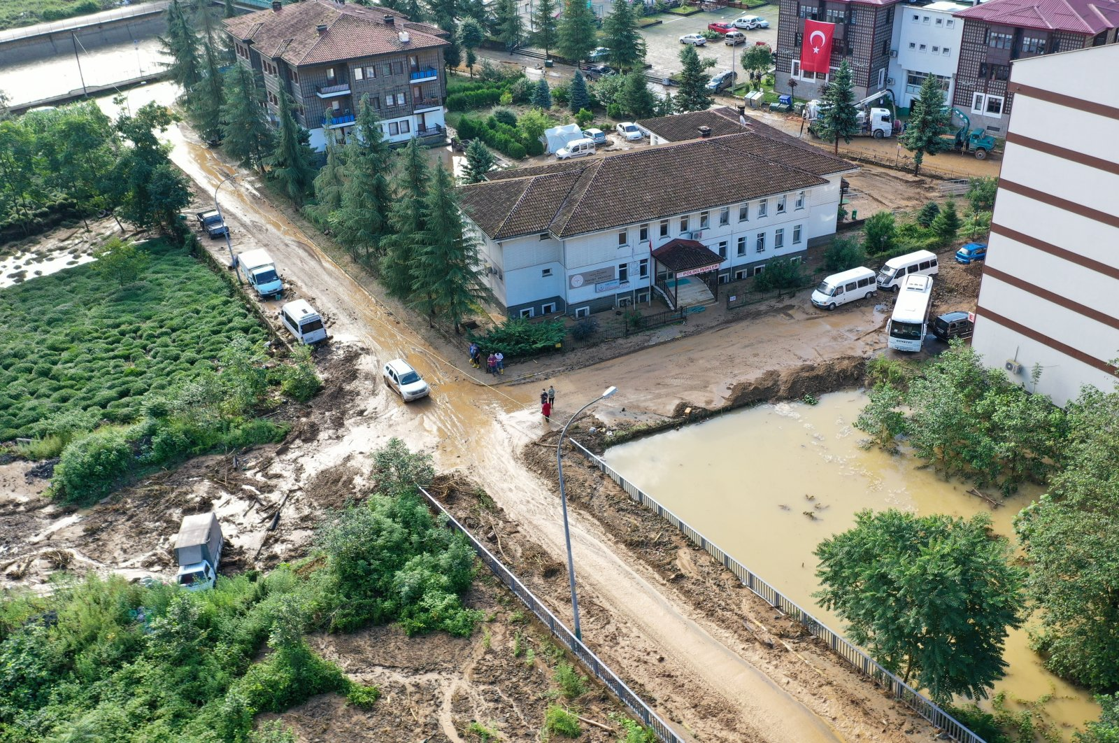 A view of Güneysu district with roads filled with debris and floodwaters, in Rize, northern Turkey, July 15, 2021. (AA Photo)