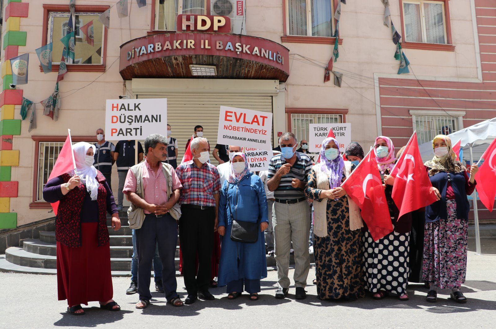 Families hold banners and placards in front of the pro-PKK HDP headquarters in Turkey's southeastern Diyarbakır province, July 14, 2021. (AA Photo)