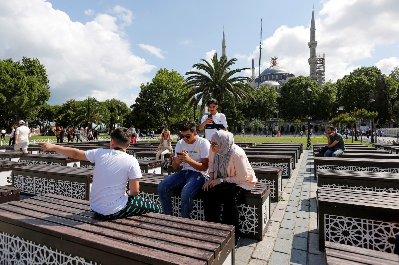 Foreign tourists pause at Sultanahmet Square as they visit the old part of Istanbul, Turkey, July 8, 2021. (Reuters Photo)