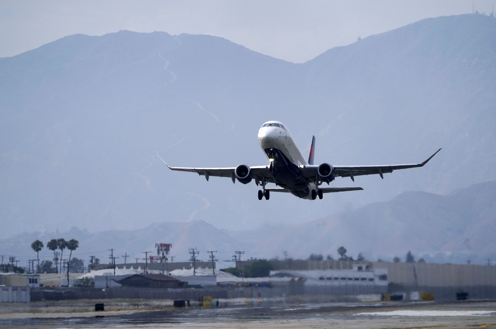 A Delta Air Lines jet takes off from Hollywood Burbank Airport in Burbank, California, U.S., July 8, 2021. (AP Photo)