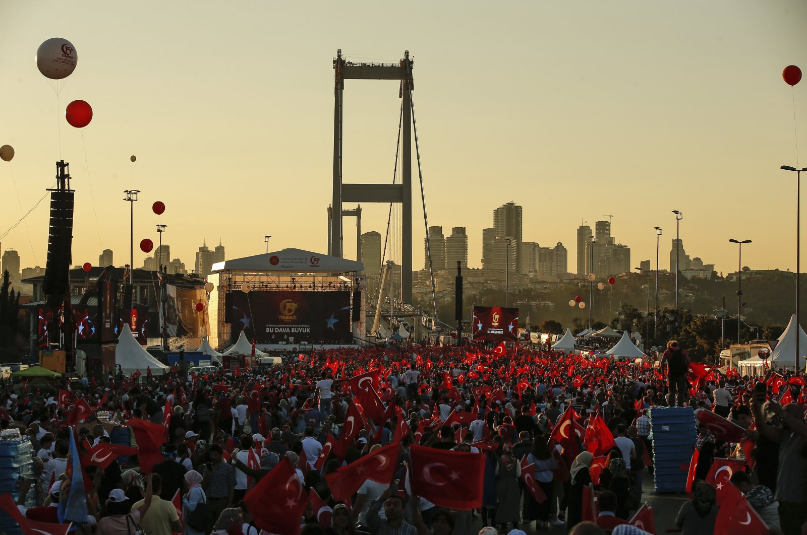 People wave Turkish flags on the road leading to the July 15 Martyrs Bridge, during a commemoration event for the second anniversary of a failed coup attempt, in Istanbul, Turkey, July 15, 2018. (AP Photo)