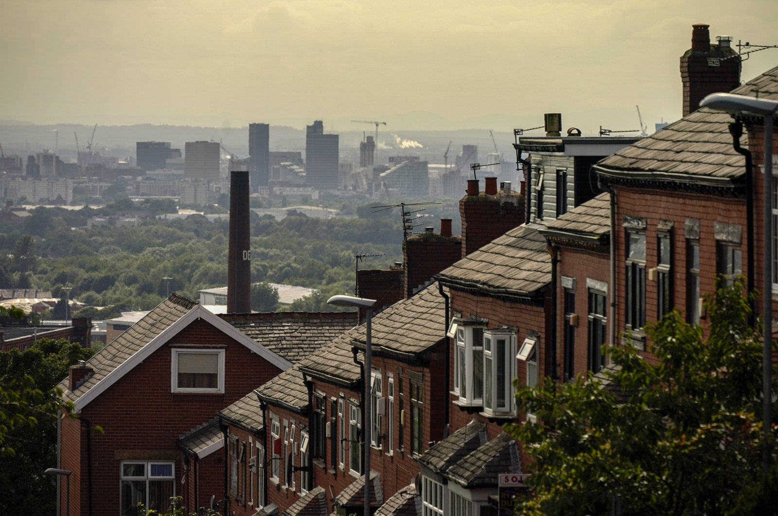 A general view of an old cotton mill in Oldham with the city of Manchester on the horizon, in Oldham, England, July 29, 2020. (Getty Images)