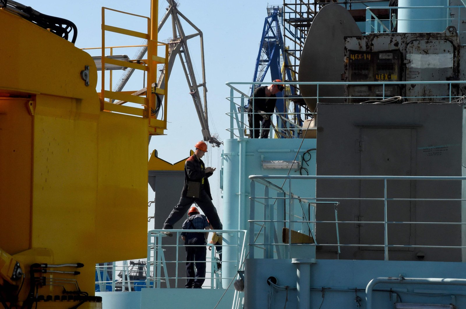 Workers seen as they work on the deck of Russia's nuclear-powered icebreaker Sibir during construction at the Baltic Shipyard in Saint-Petersburg, Russia, July 5, 2021. (AFP Photo)