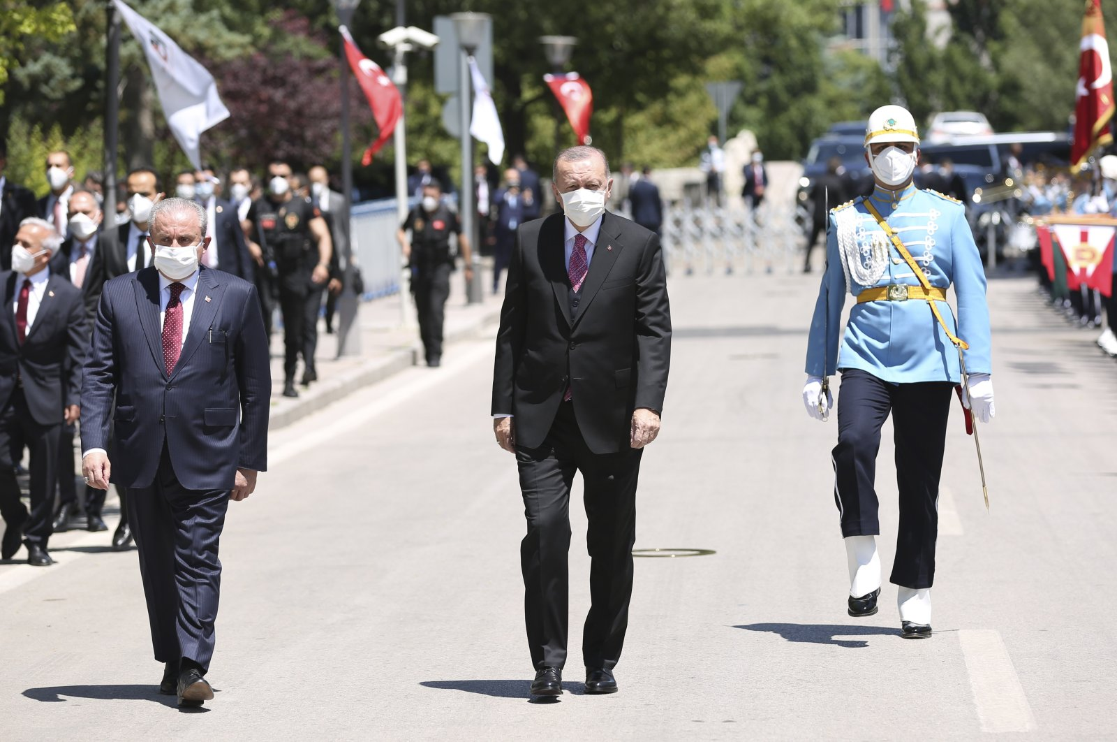 President Recep Tayyip Erdoğan, Turkish Parliament Speaker Mustafa Şentop walk toward the commemoration ceremony held in the capital Ankara, Turkey, July 15, 2021. (IHA Photo)