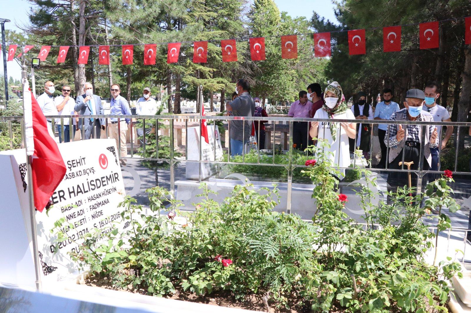 People pray by the graveside of Ömer Halisdemir, in Niğde, central Turkey, July 15, 2021. (AA PHOTO)