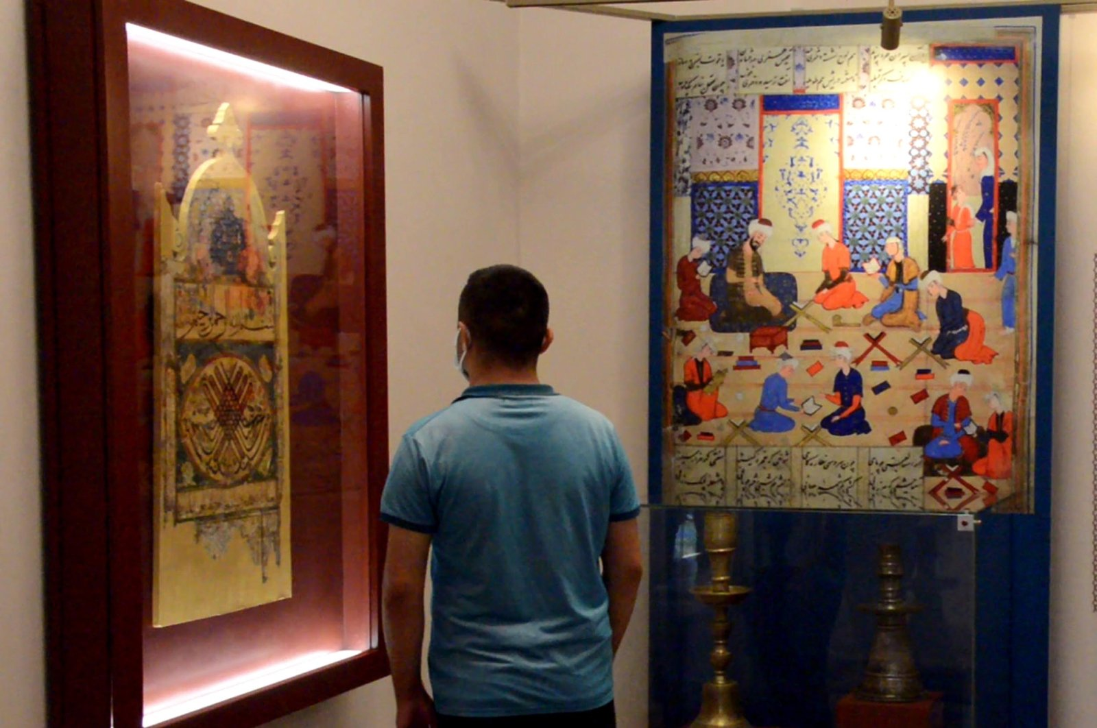 A visitor examines works in the Çifte Minareli Medrese, Erzurum, eastern Turkey, July 15, 2021. (DHA Photo)